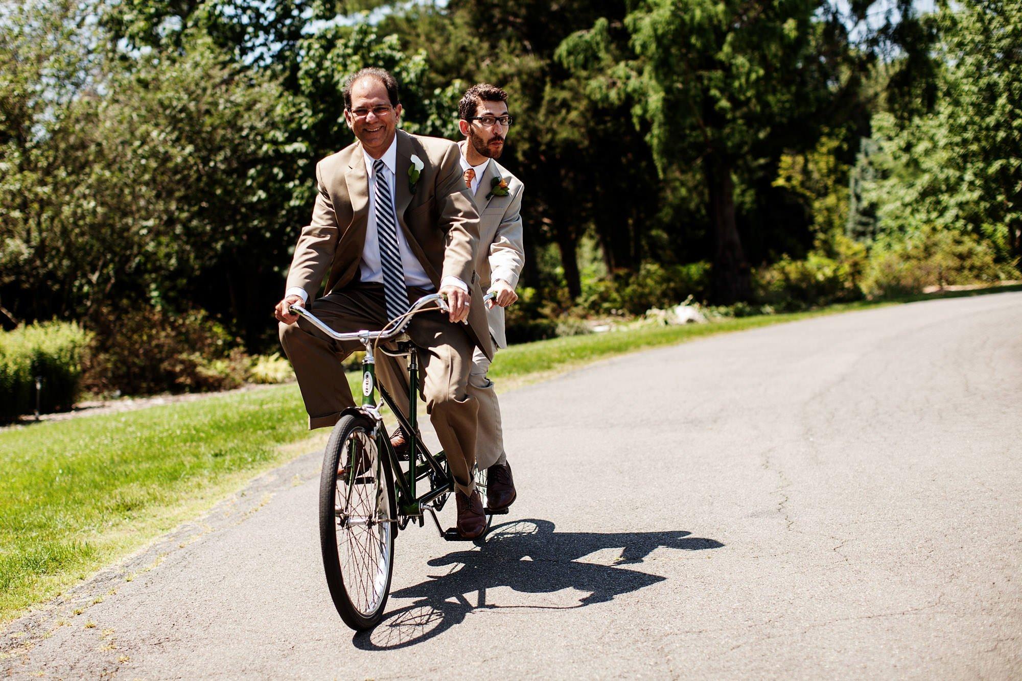 Groomsmen ride at bike at River Farm Alexandria.