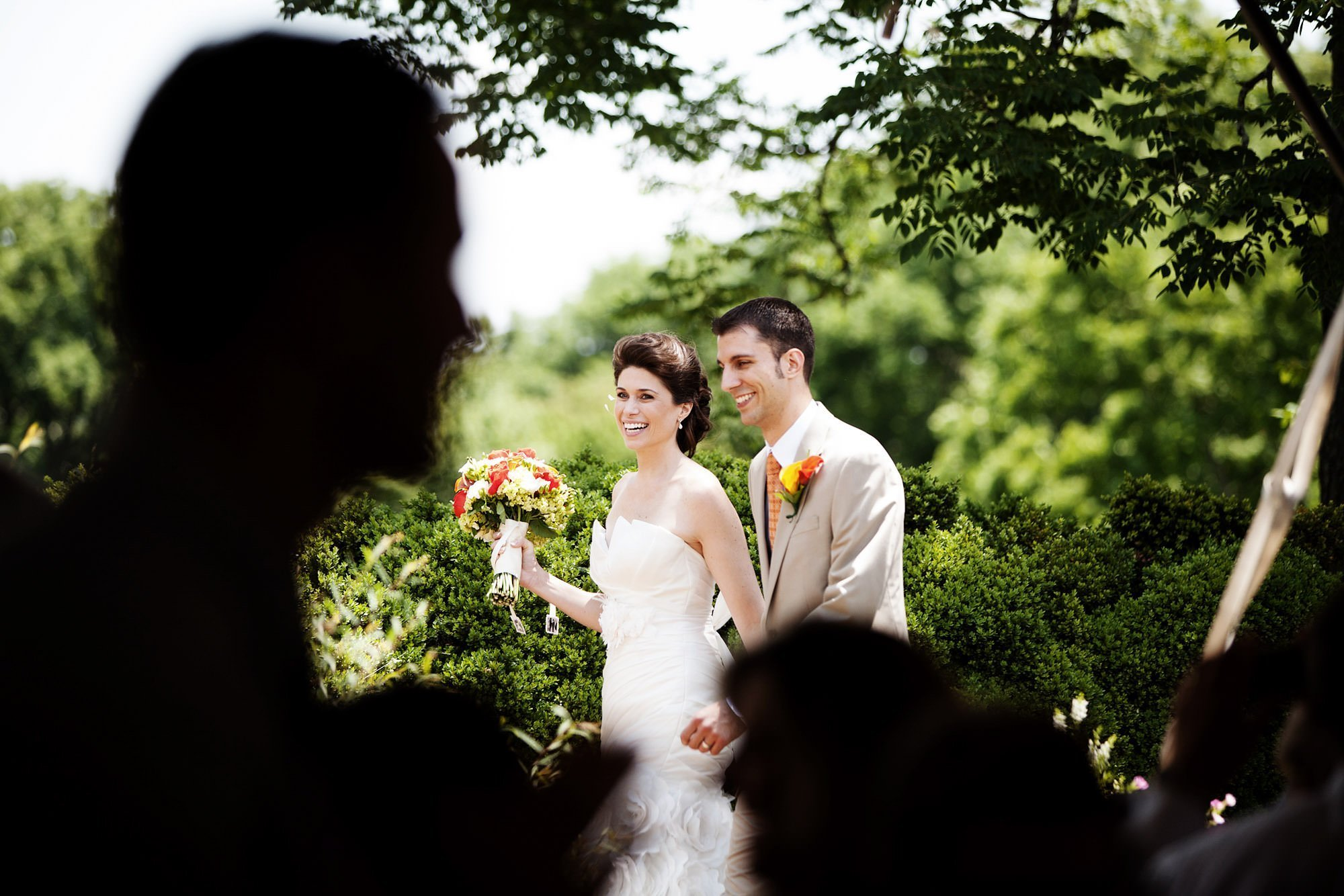 The couple is introduced to the tented wedding reception at River Farm Alexandria.