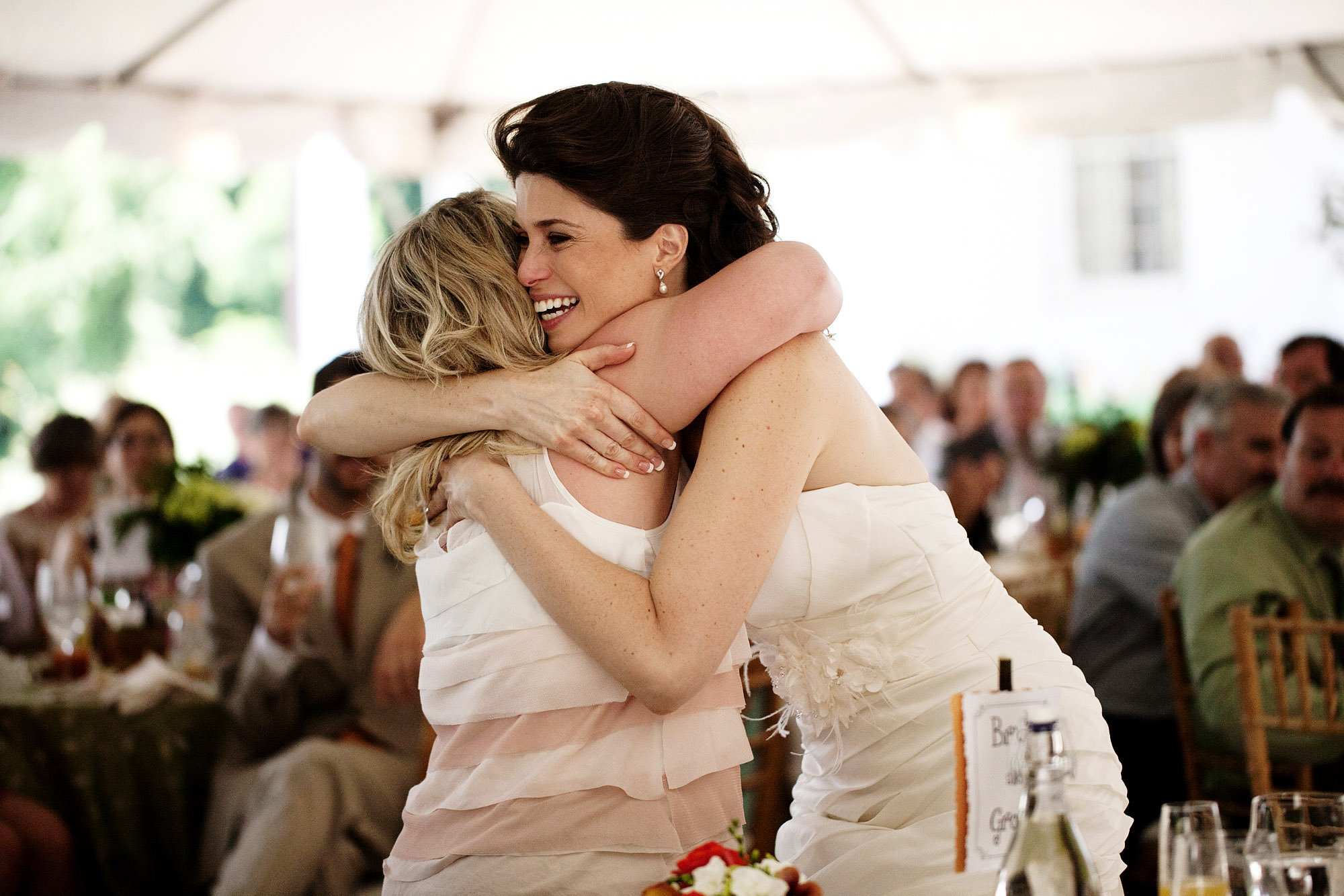 The bride hugs her maid of honor.