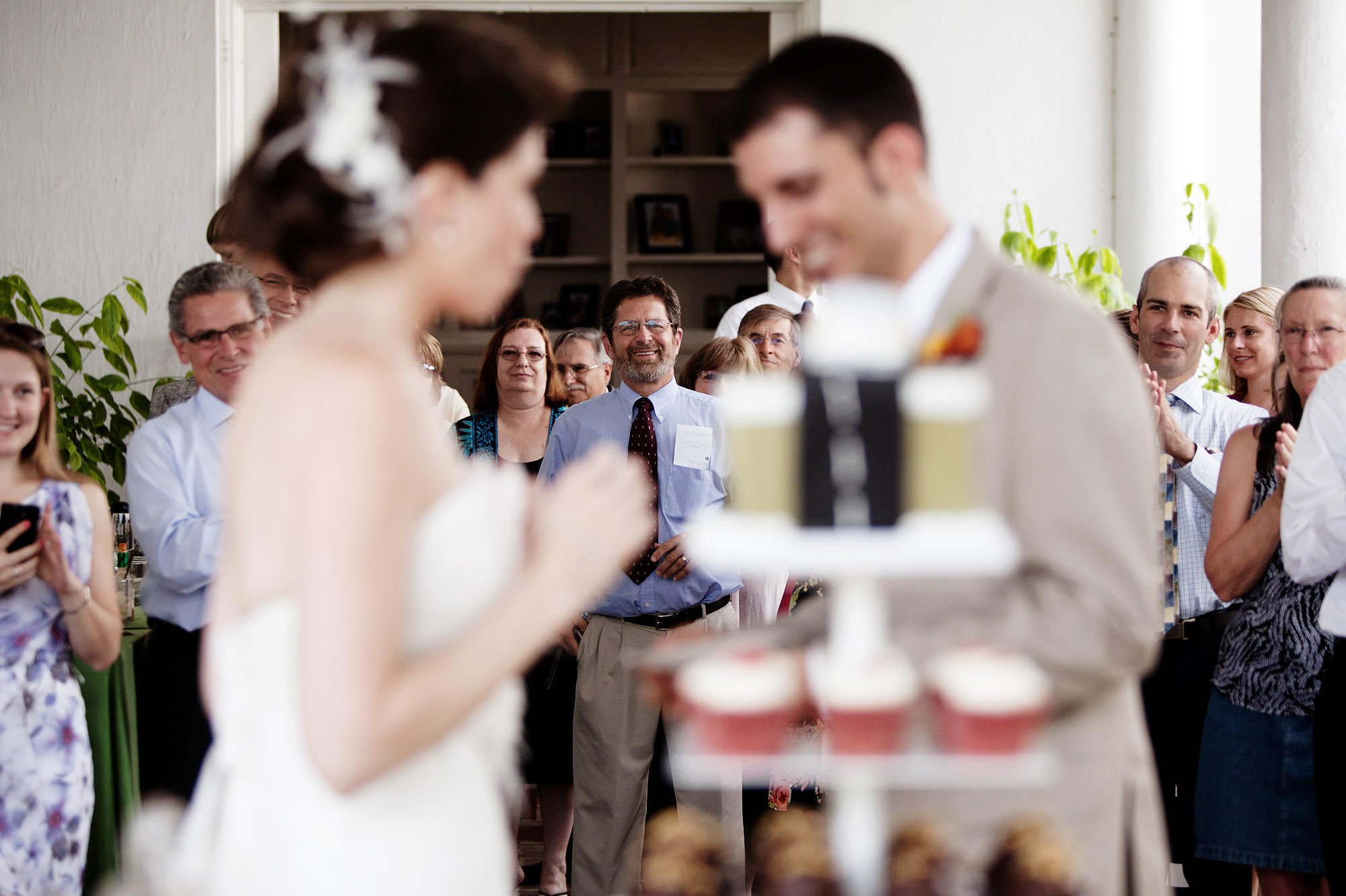 Guests watch the couple cut the cake during the River Farm Alexandria Wedding reception.
