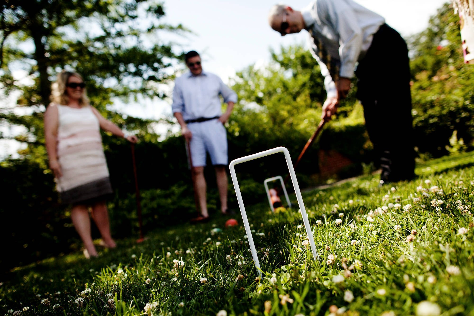 Guests play croquet during cocktail hour of this River Farm Alexandria Wedding.