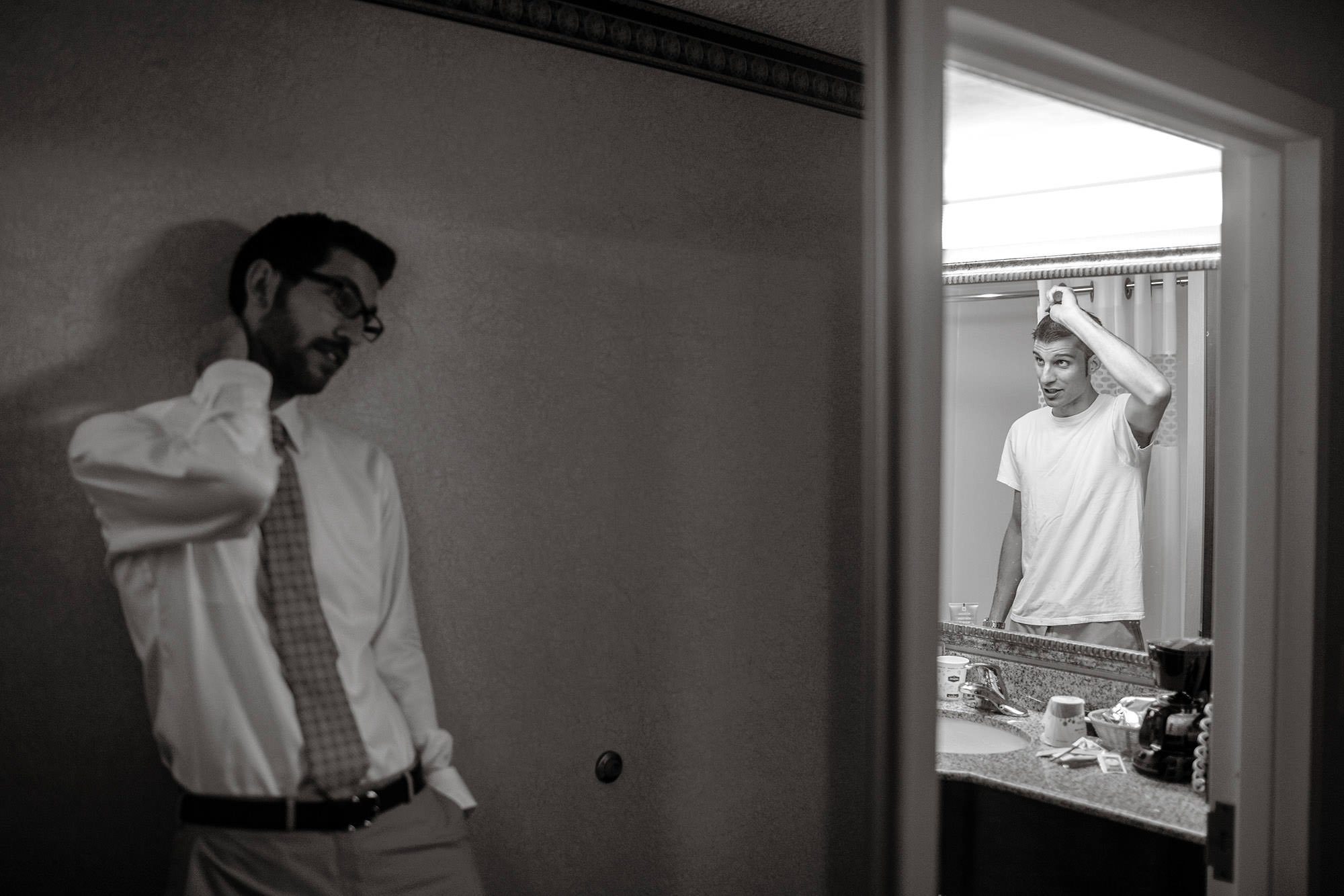 The groom combs his hair before the River Farm Alexandria Wedding ceremony.