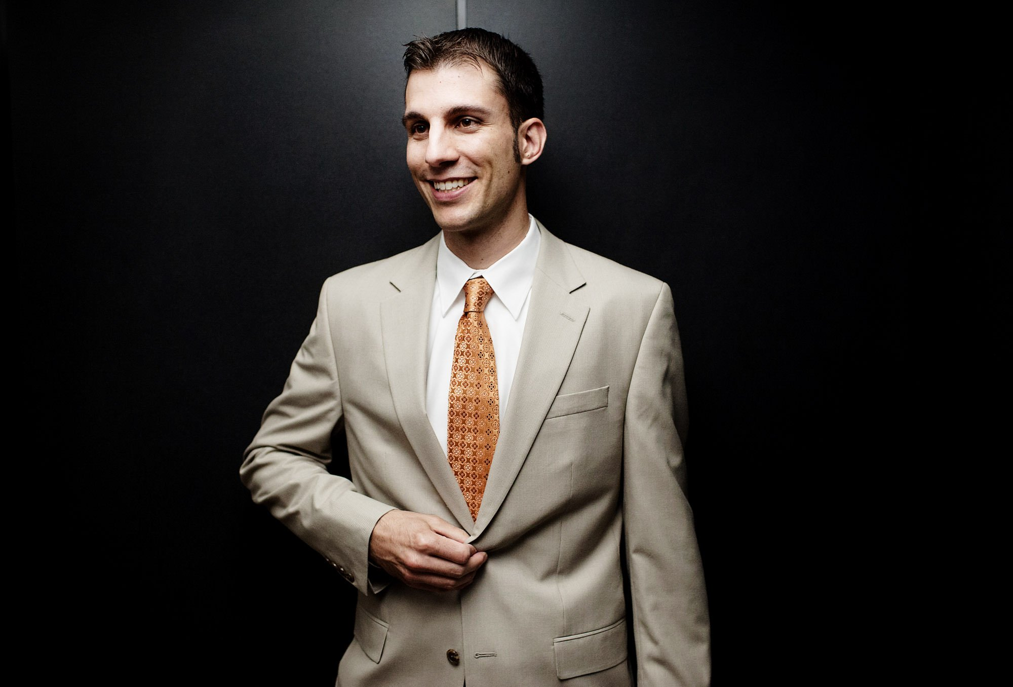 A portrait of the groom in an elevator.
