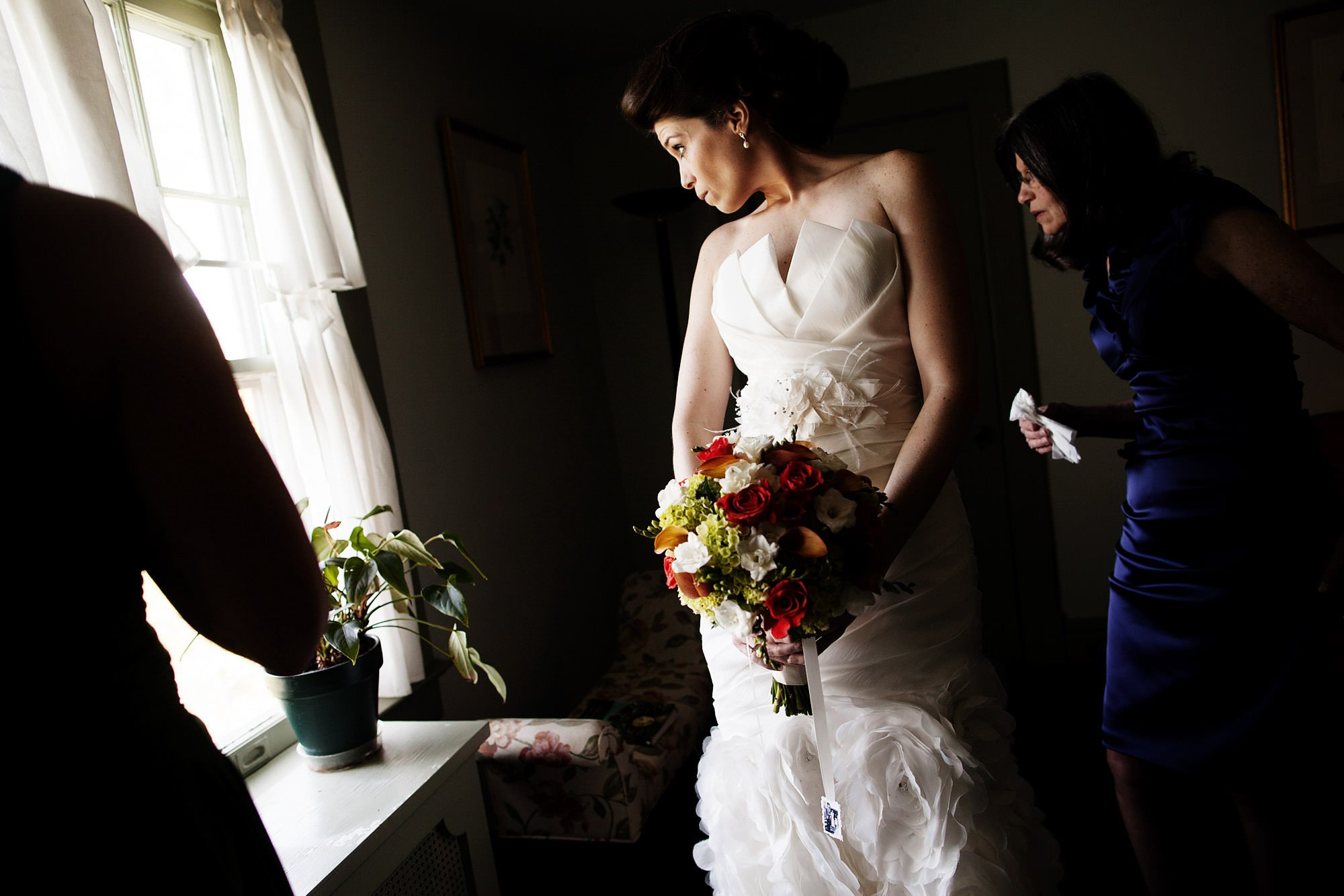 The bride looks at arriving guests before the River Farm Alexandria Wedding ceremony.