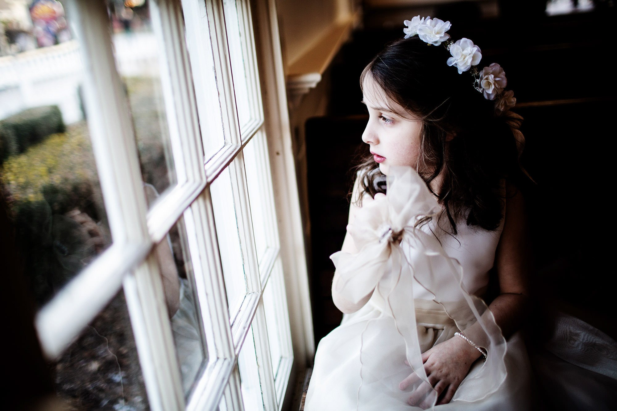 A flower girl during the wedding ceremony.