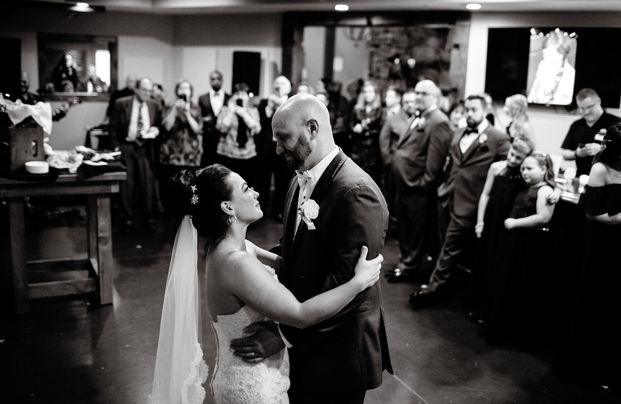 The couple share their first dance during the Silver Oak Mystic wedding reception.