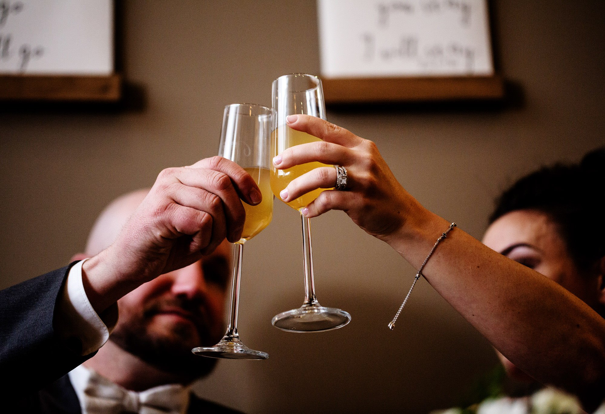 The bride and groom toast during the wedding reception at Silver Oak Mystic.