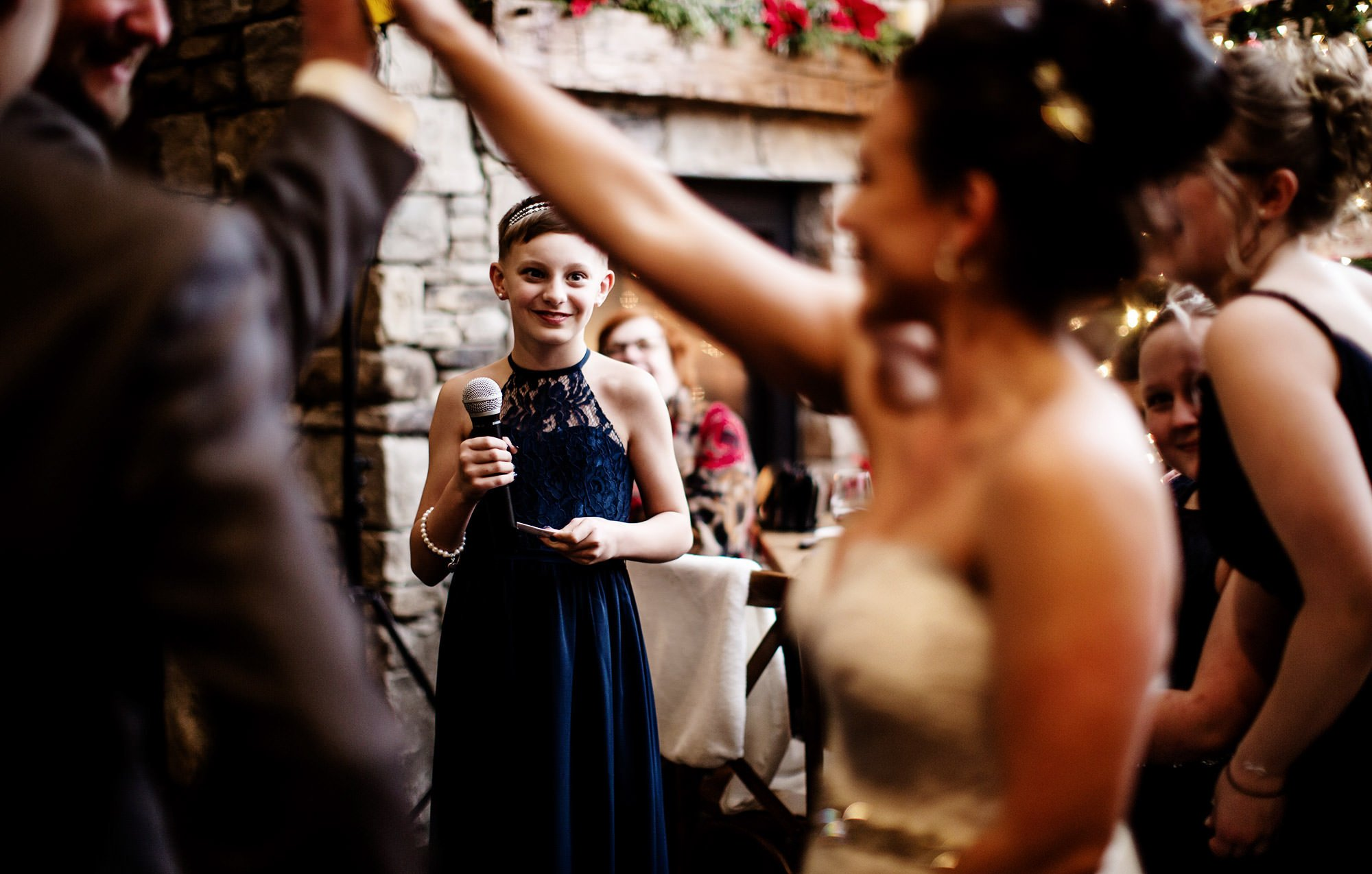A bridesmaid gives a toast during the Silver Oak Mystic wedding reception.