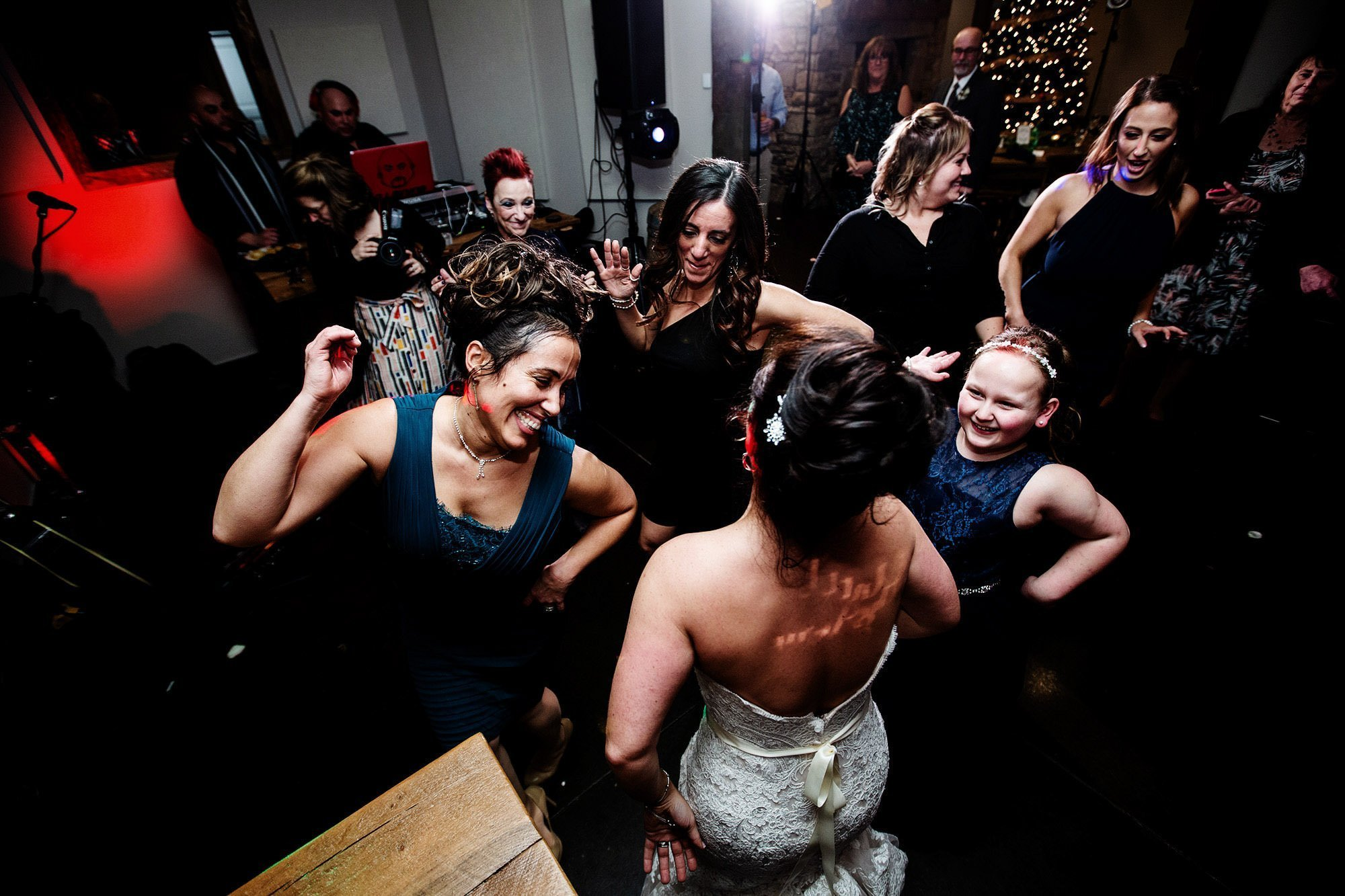 The bride dances with her guests during the Silver Oak Mystic wedding reception.