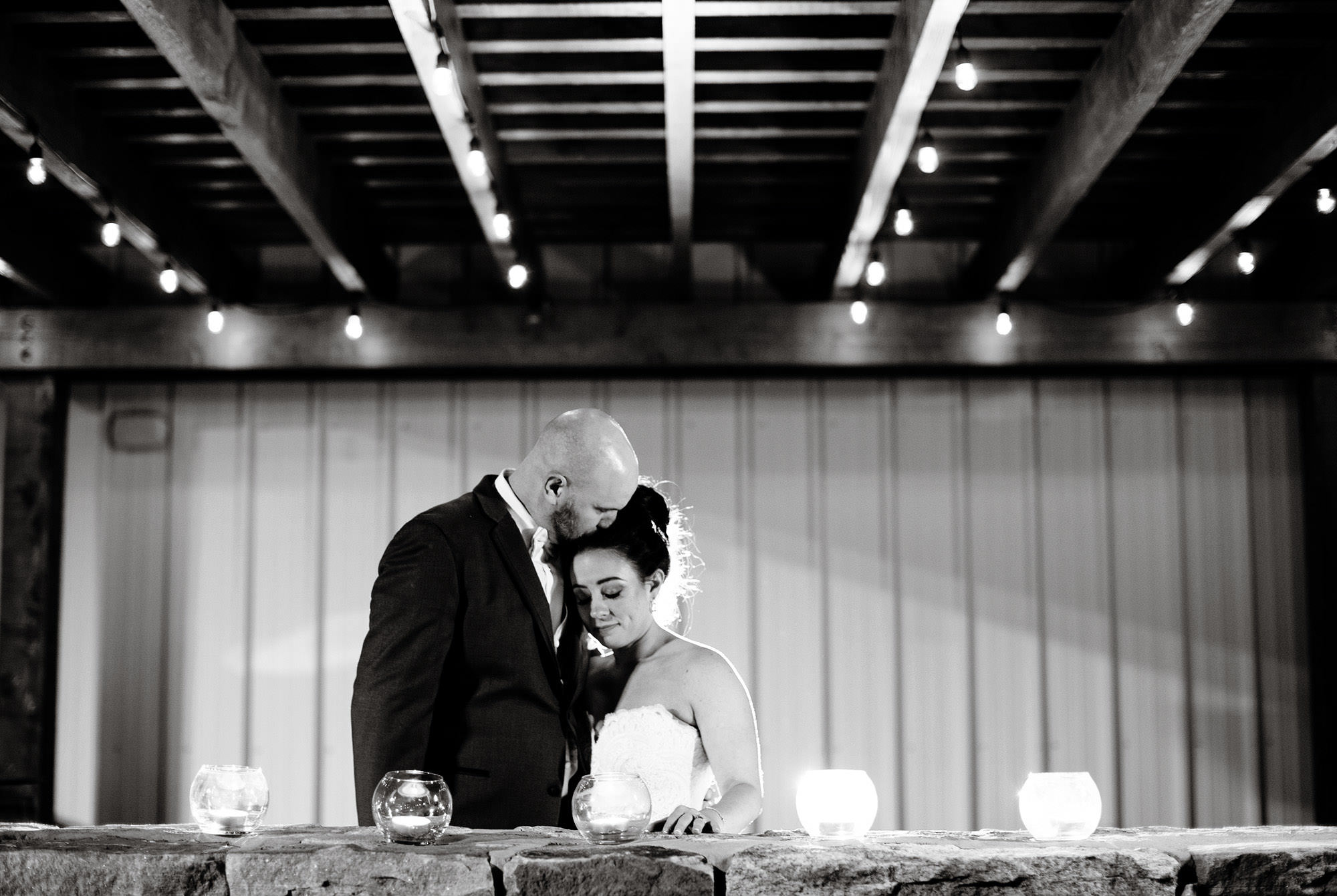 The couple poses for a portrait during the Silver Oak Mystic wedding reception.