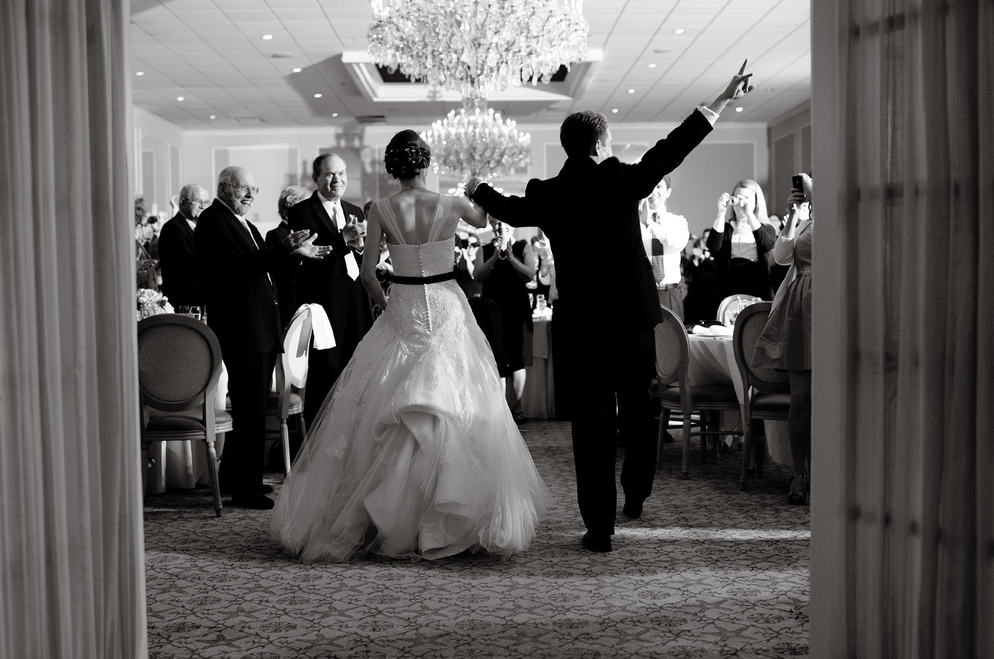 The bride and groom are introduced to the wedding reception at Spring Lake Bath and Tennis Club in Spring Lake, NJ.