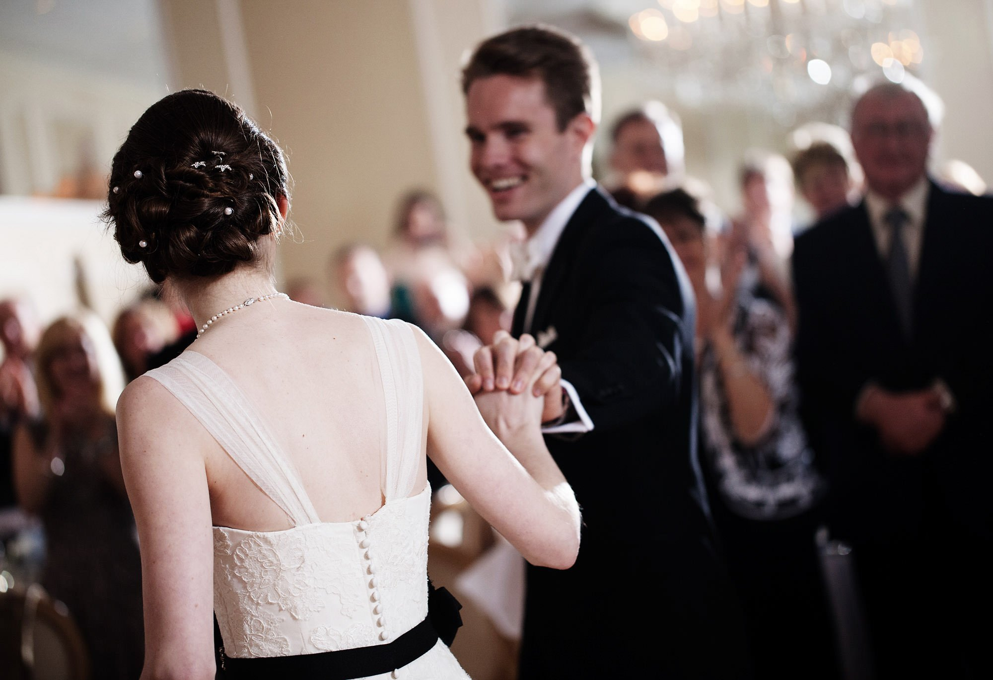 The bride and groom share their first dance during their Spring Lake Bath and Tennis Club wedding reception.