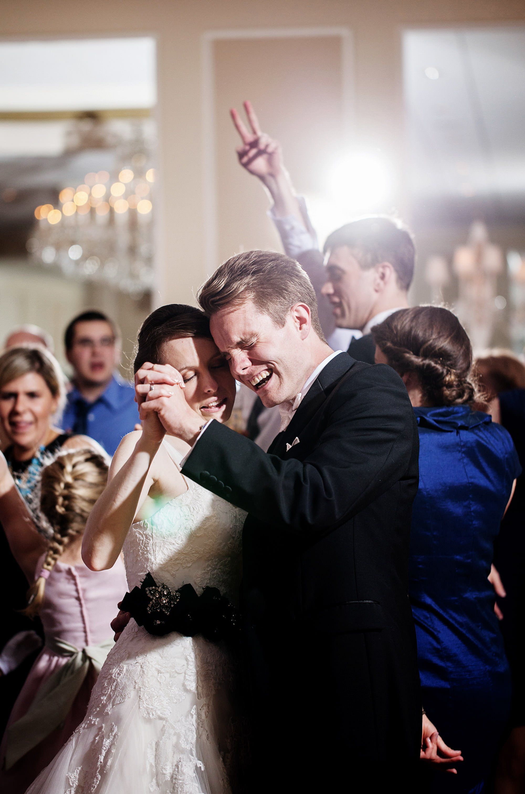 The bride and groom dance with their guests during their Spring Lake Bath and Tennis Club wedding reception.