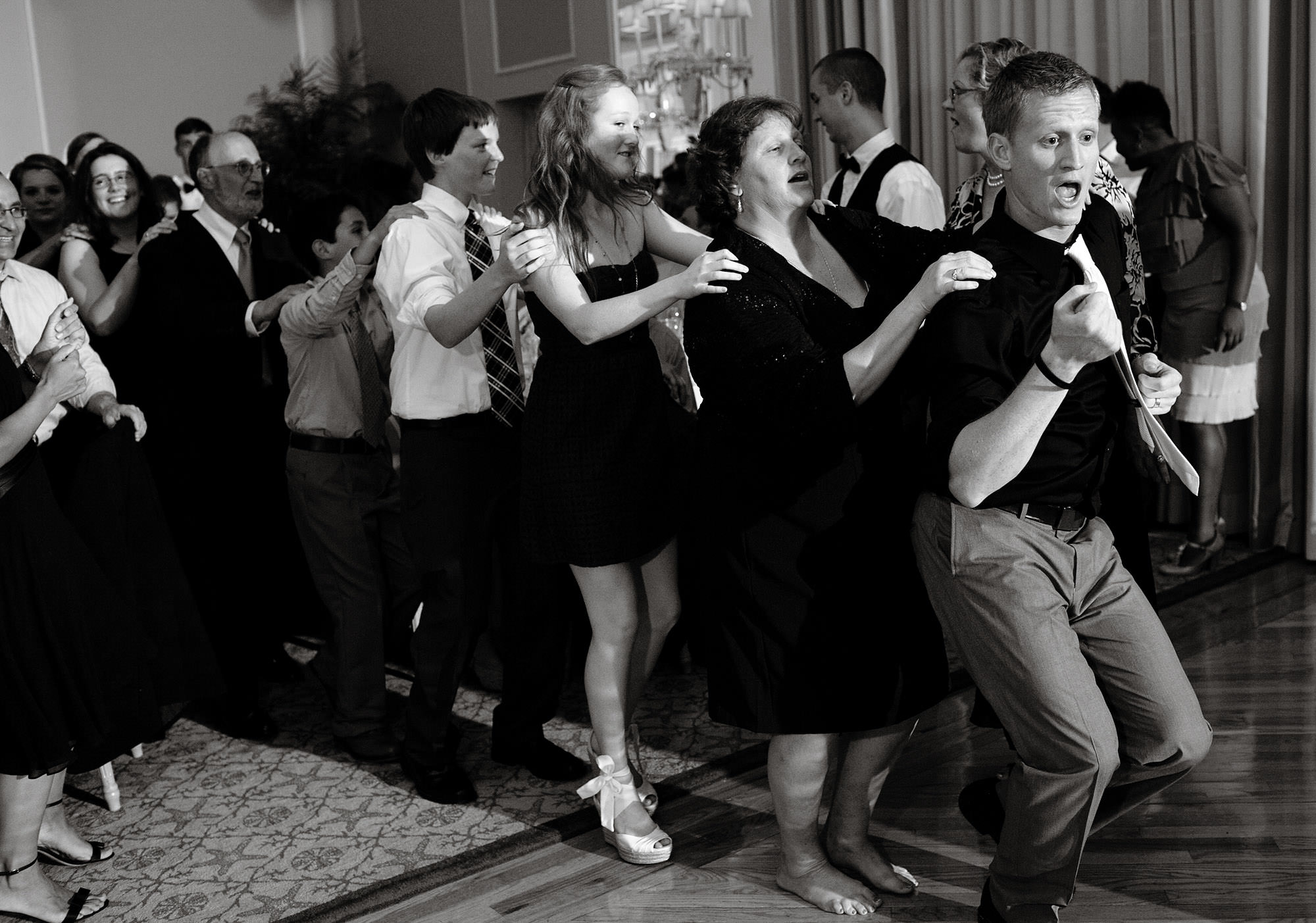 Guests dance during the wedding reception at Spring Lake Bath and Tennis Club.