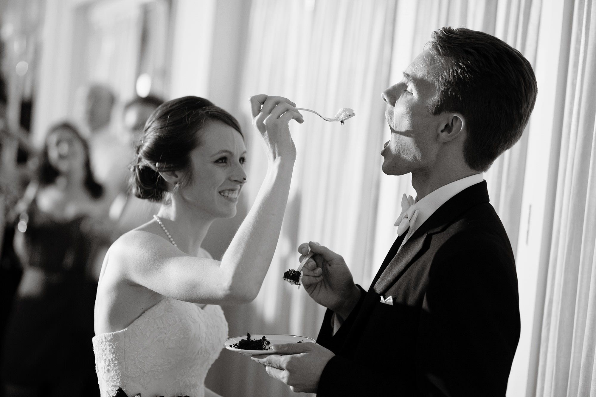 The bride and groom cut their cake during their Spring Lake Bath and Tennis Club wedding reception.