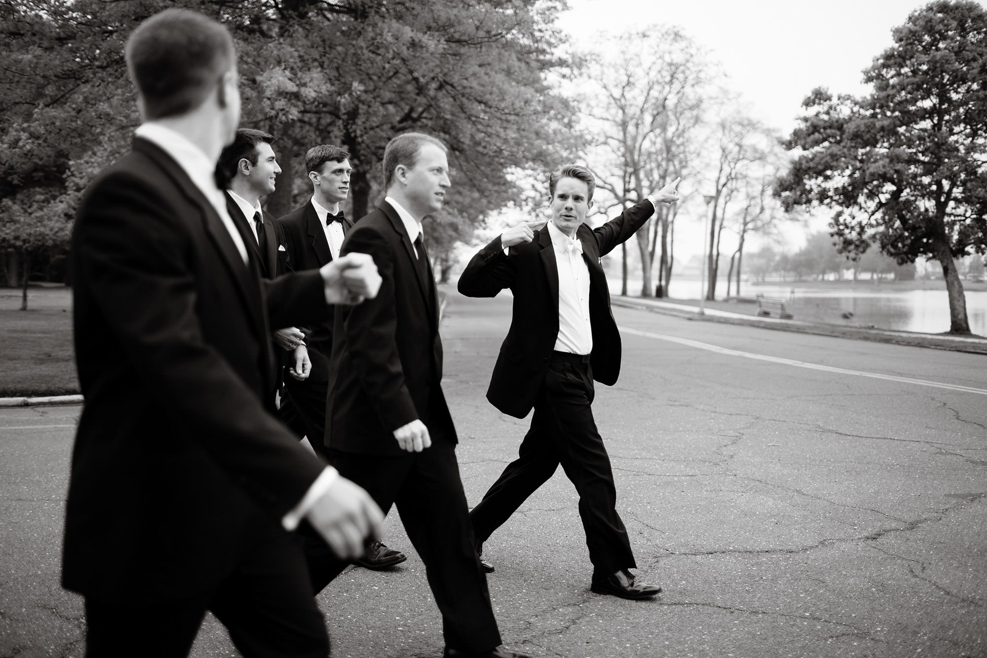 The groomsmen walk through Spring Lake, NJ prior to the wedding ceremony at St. Catherine's Church.