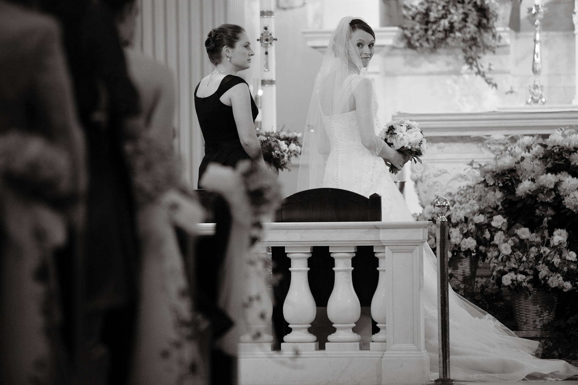 The bride looks at her guests during the wedding ceremony at St. Catherine Church in Spring Lake, NJ