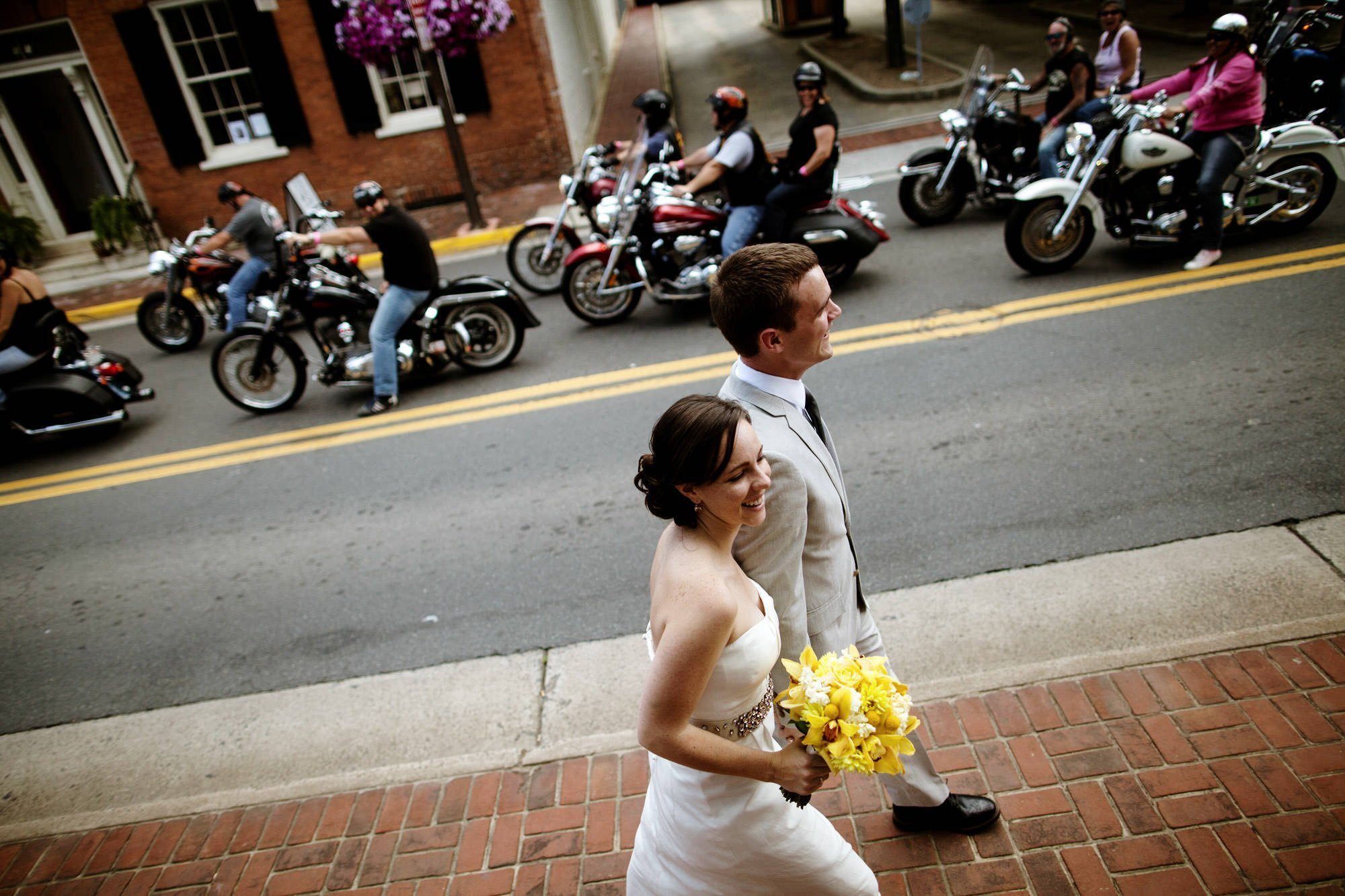 The bride and groom walk through Downtown Leesburg before their Sunset Hills Vineyard wedding.