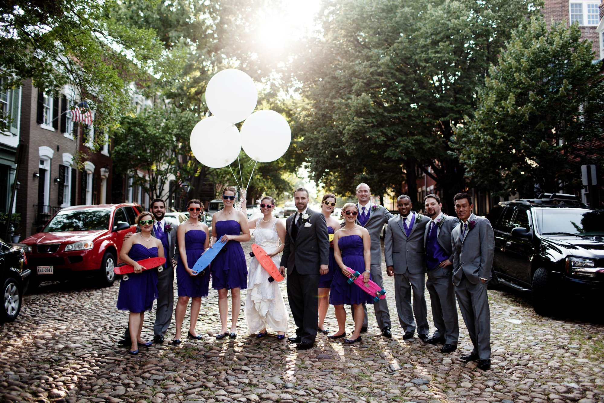 The wedding party poses for a portrait in Olde Town Alexandria before the Topedo Factory wedding.