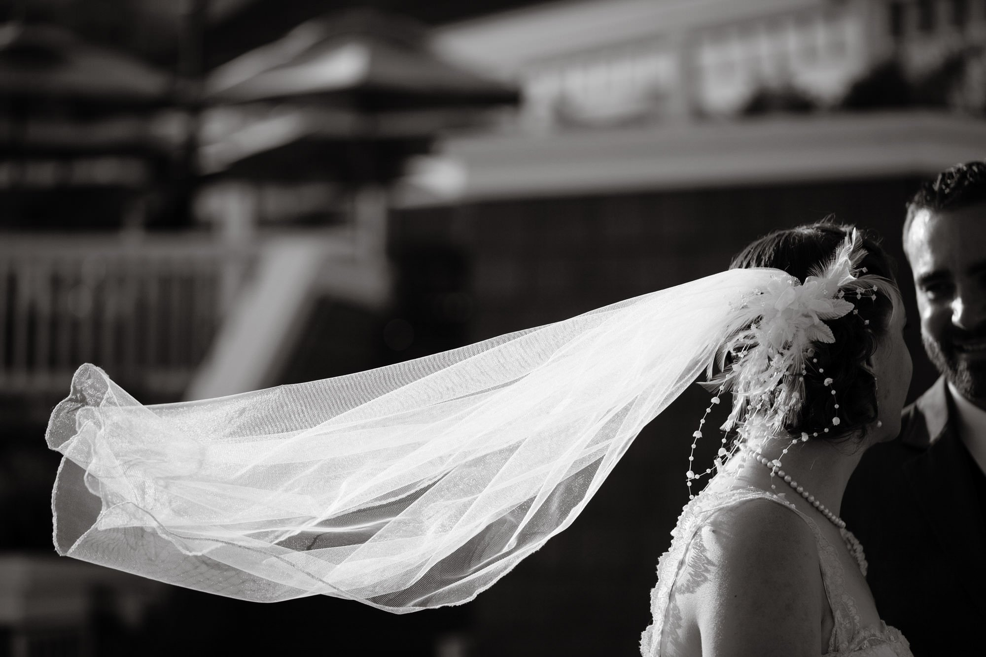 The bride's veil blows in the wind in Alexandria before the wedding ceremony at Topedo Factory.