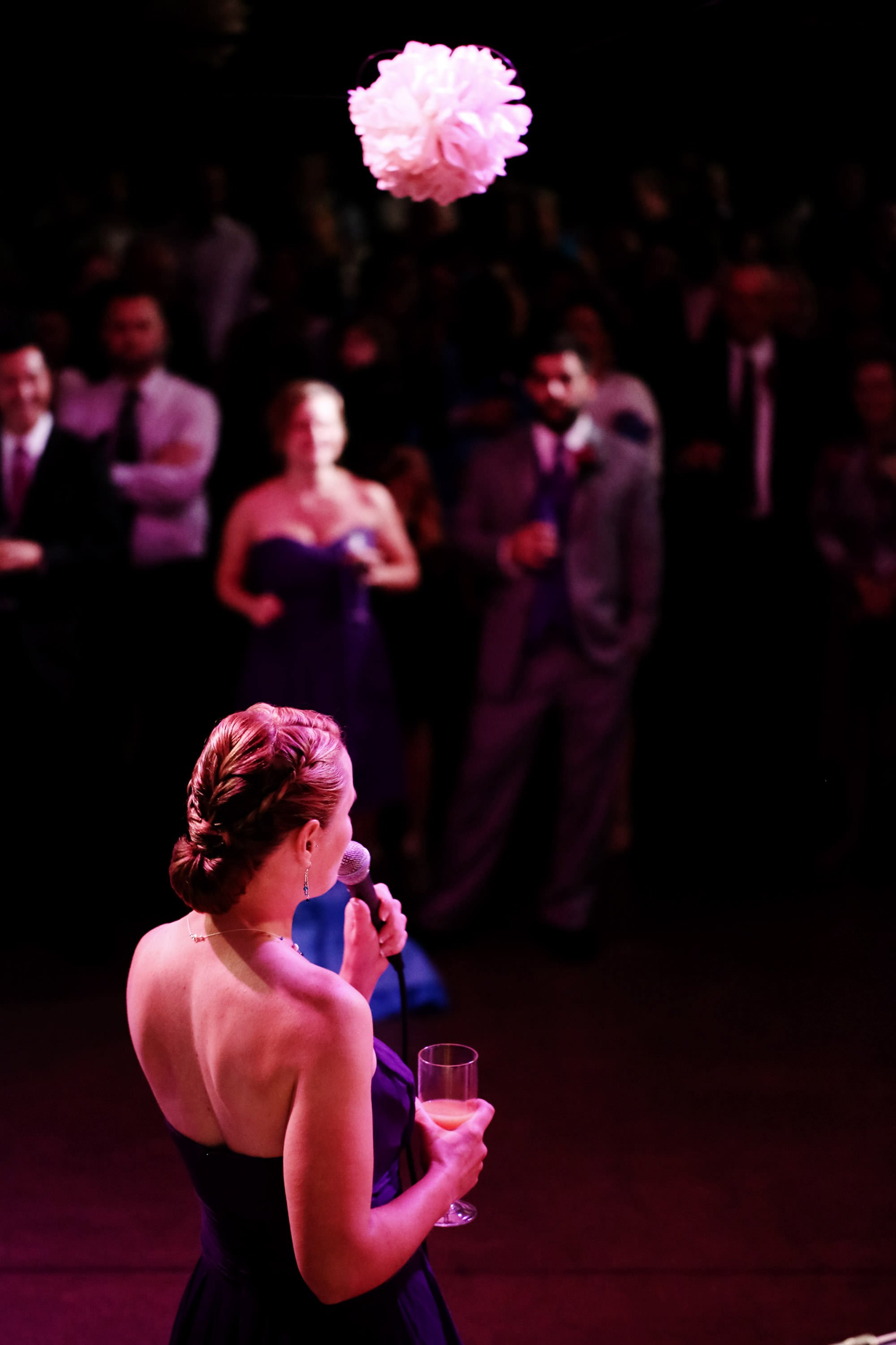 A bridesmaid gives a toast during the wedding reception at Topedo Factory.