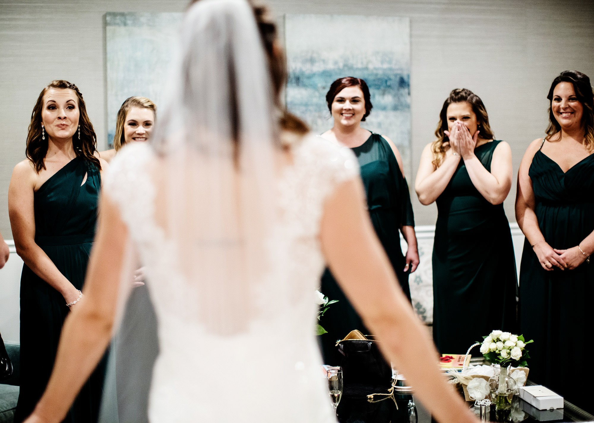Bridesmaids react to the bride in her dress before the The Villa at Ridder Country Club Wedding ceremony.