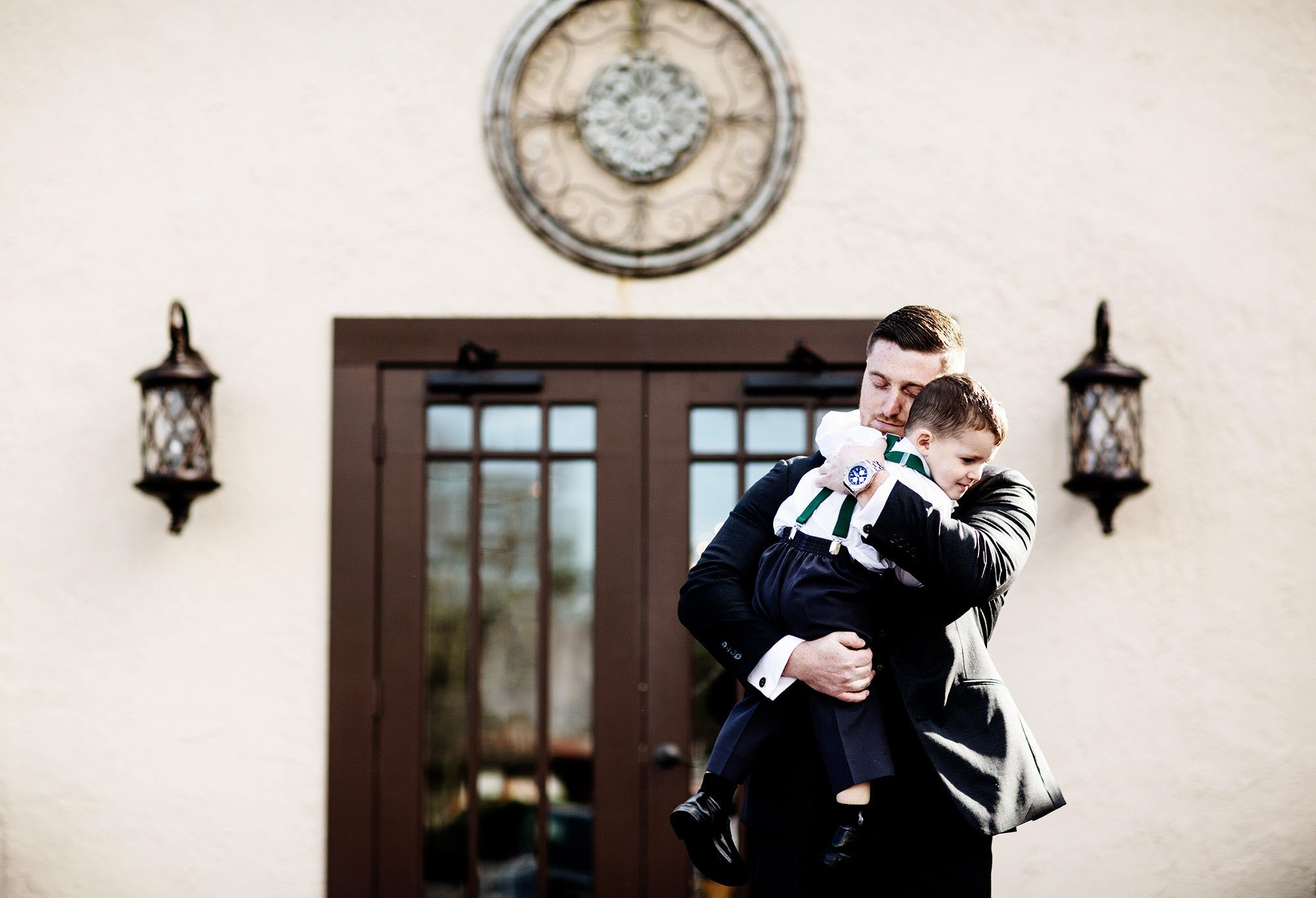 The groom hugs his son before The Villa at Ridder Country Club Wedding ceremony.