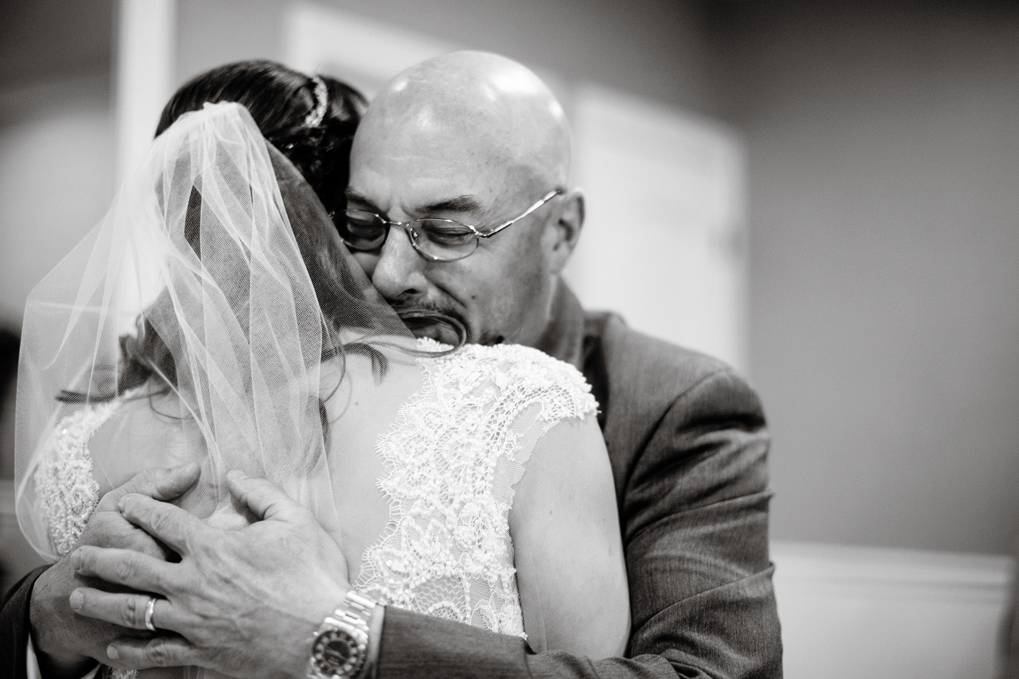 The bride hugs her father before The Villa at Ridder Country Club Wedding ceremony.