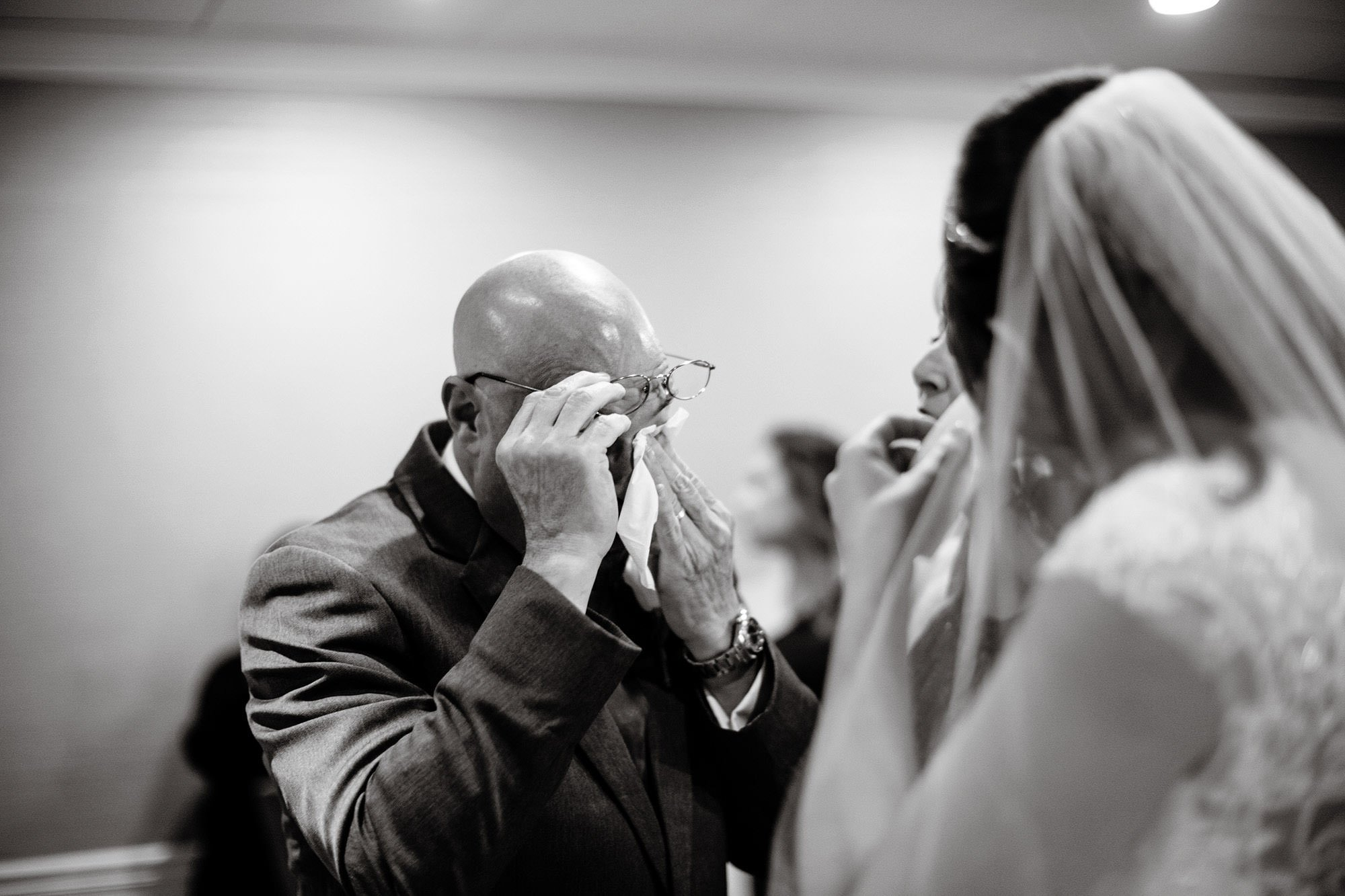 The bride and her father shed some tears before the wedding ceremony at The Villa at Ridder Country Club.