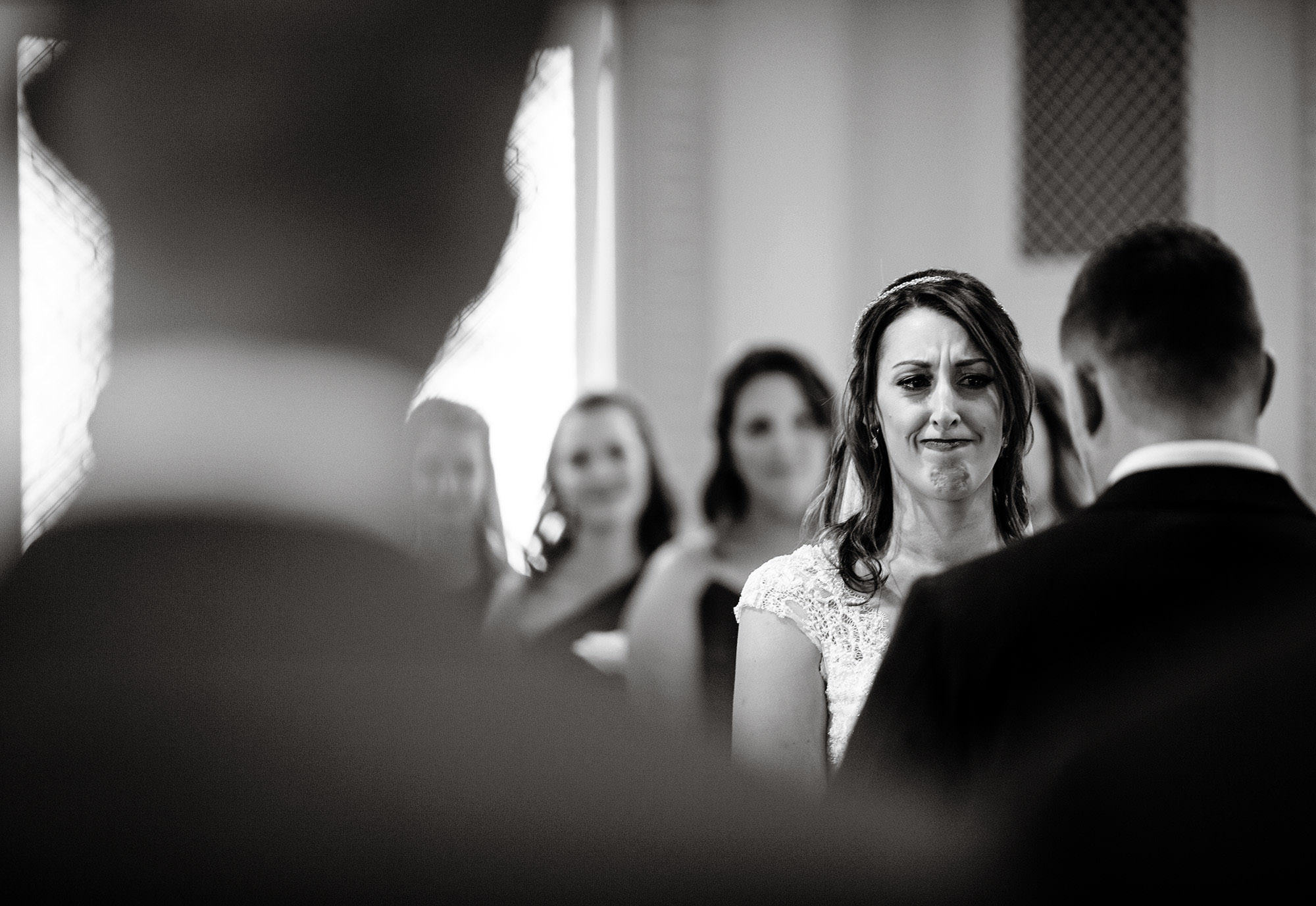 The bride gets emotional during The Villa at Ridder Country Club Wedding ceremony.