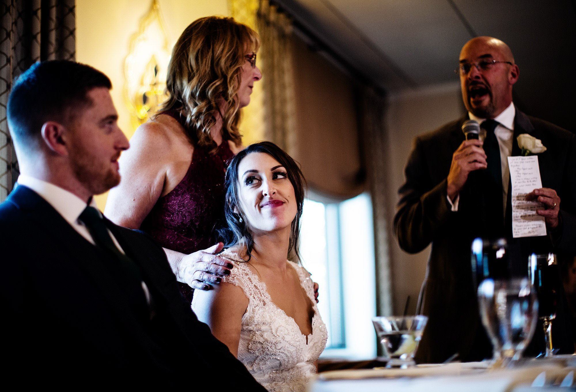 The bride looks at her groom during toasts at The Villa at Ridder Country Club.