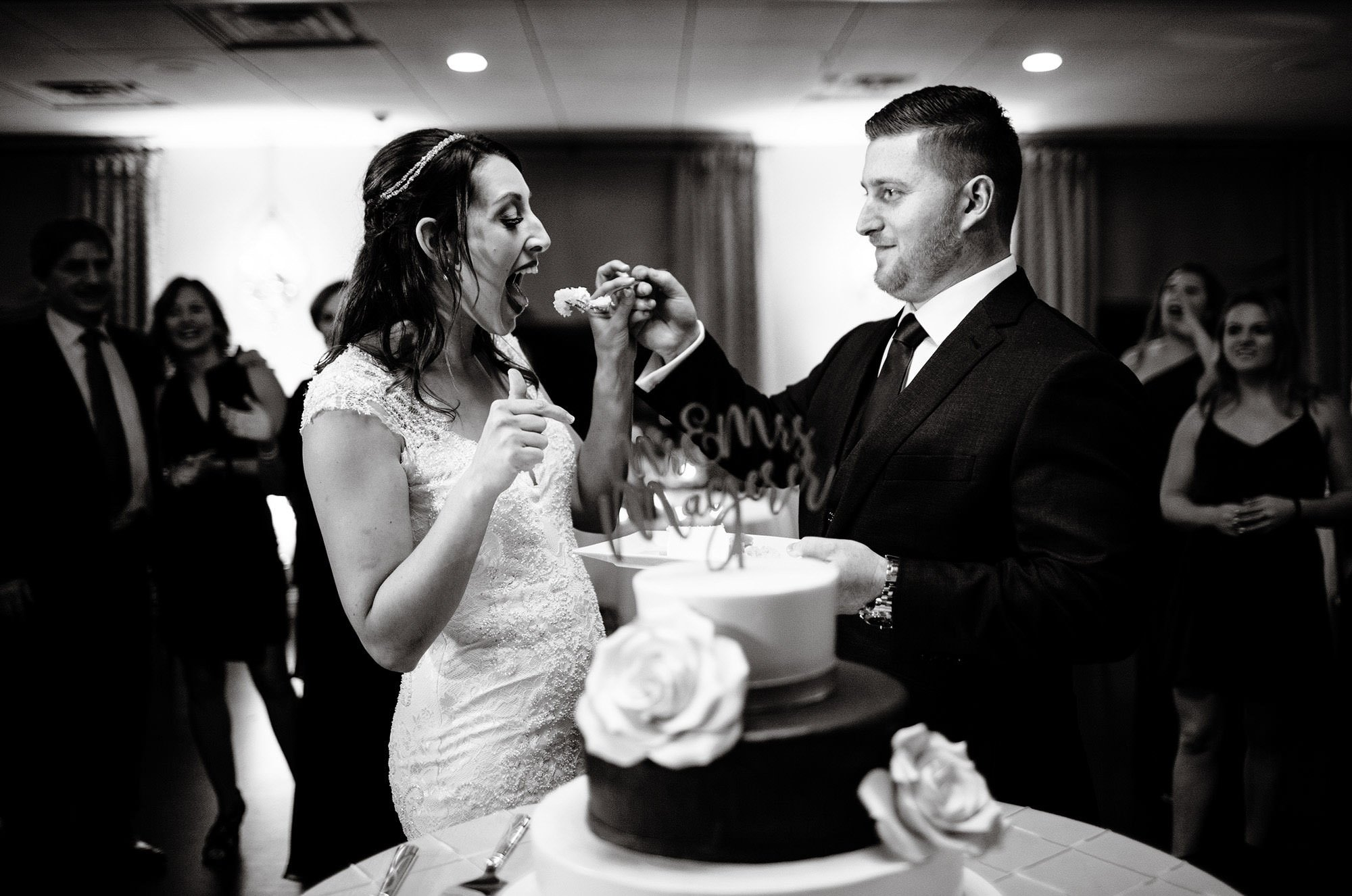 The couple cuts their cake during The Villa at Ridder Country Club wedding reception.