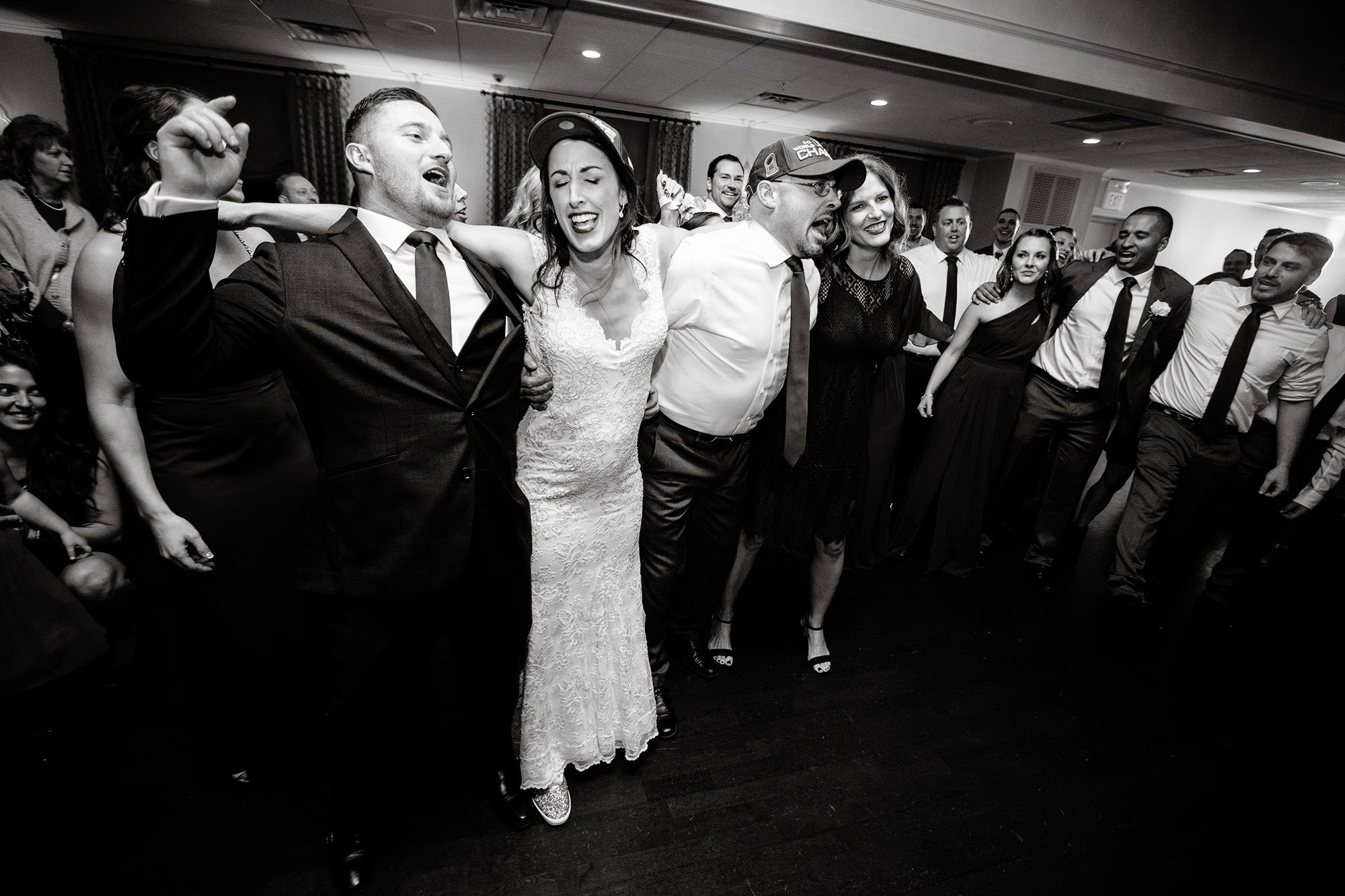 The couple dances with their guests during The Villa at Ridder Country Club wedding reception.