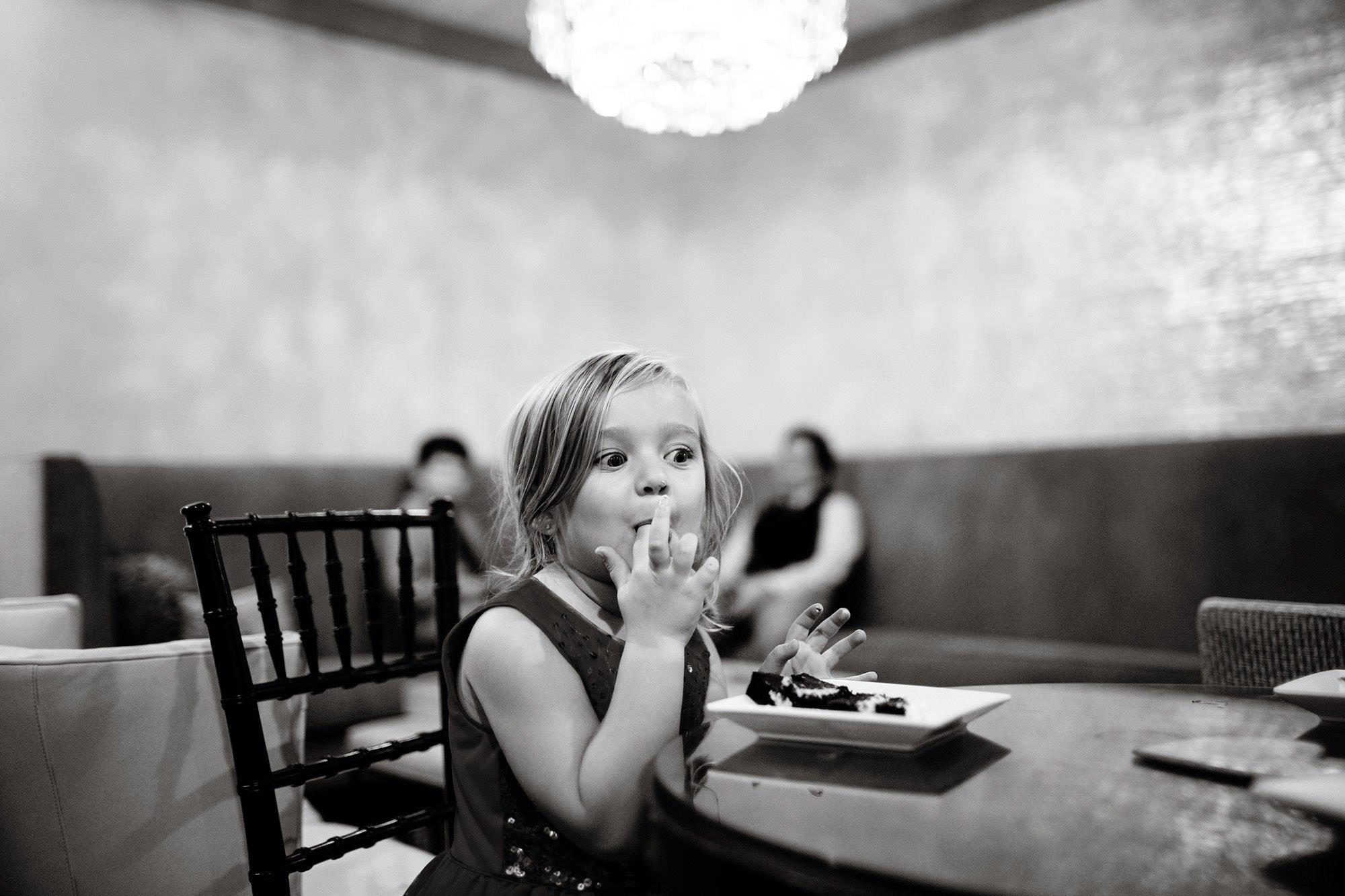 A girl enjoys her cake.