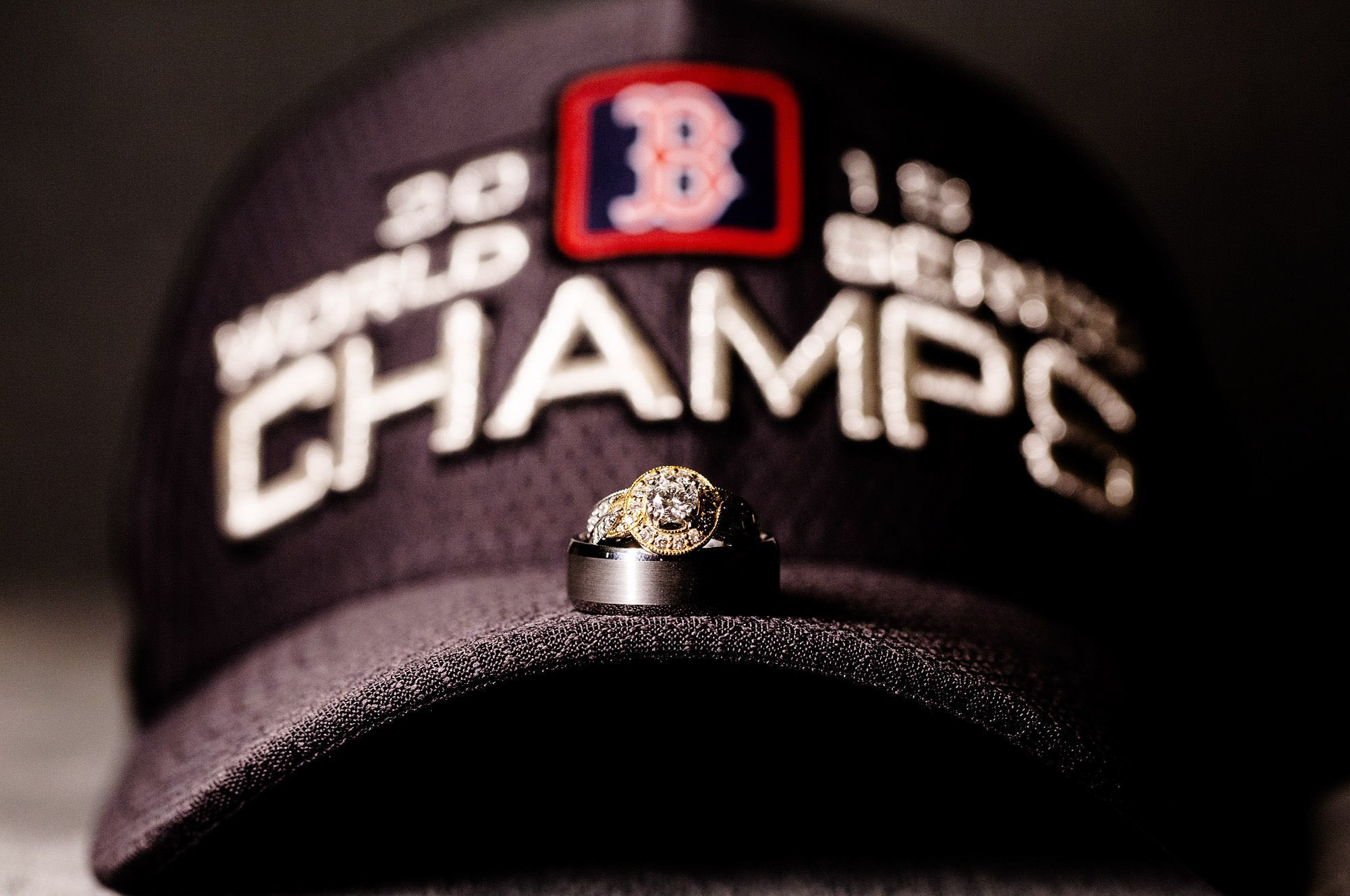 A ring detail on a Boston Red Sox Champs hat.