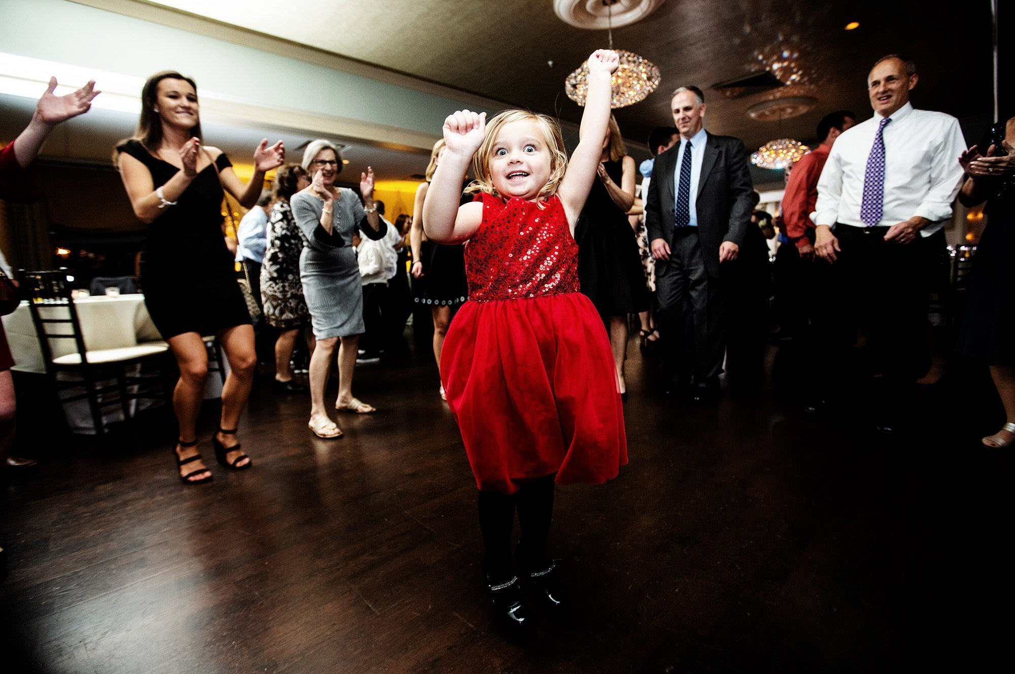 An excited girl dances during The Villa at Ridder Country Club wedding reception.