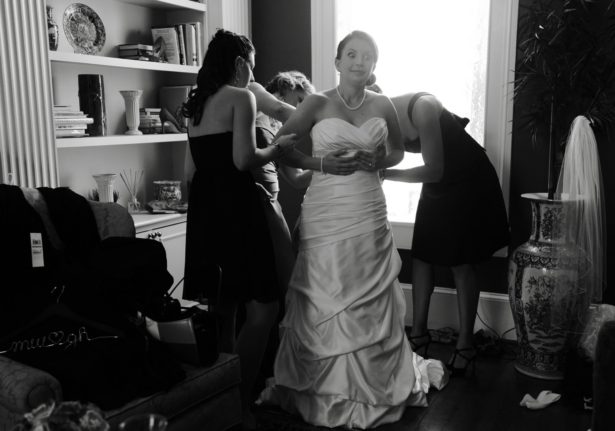 The bride puts on her wedding dress before the Whitehall Estate wedding ceremony.