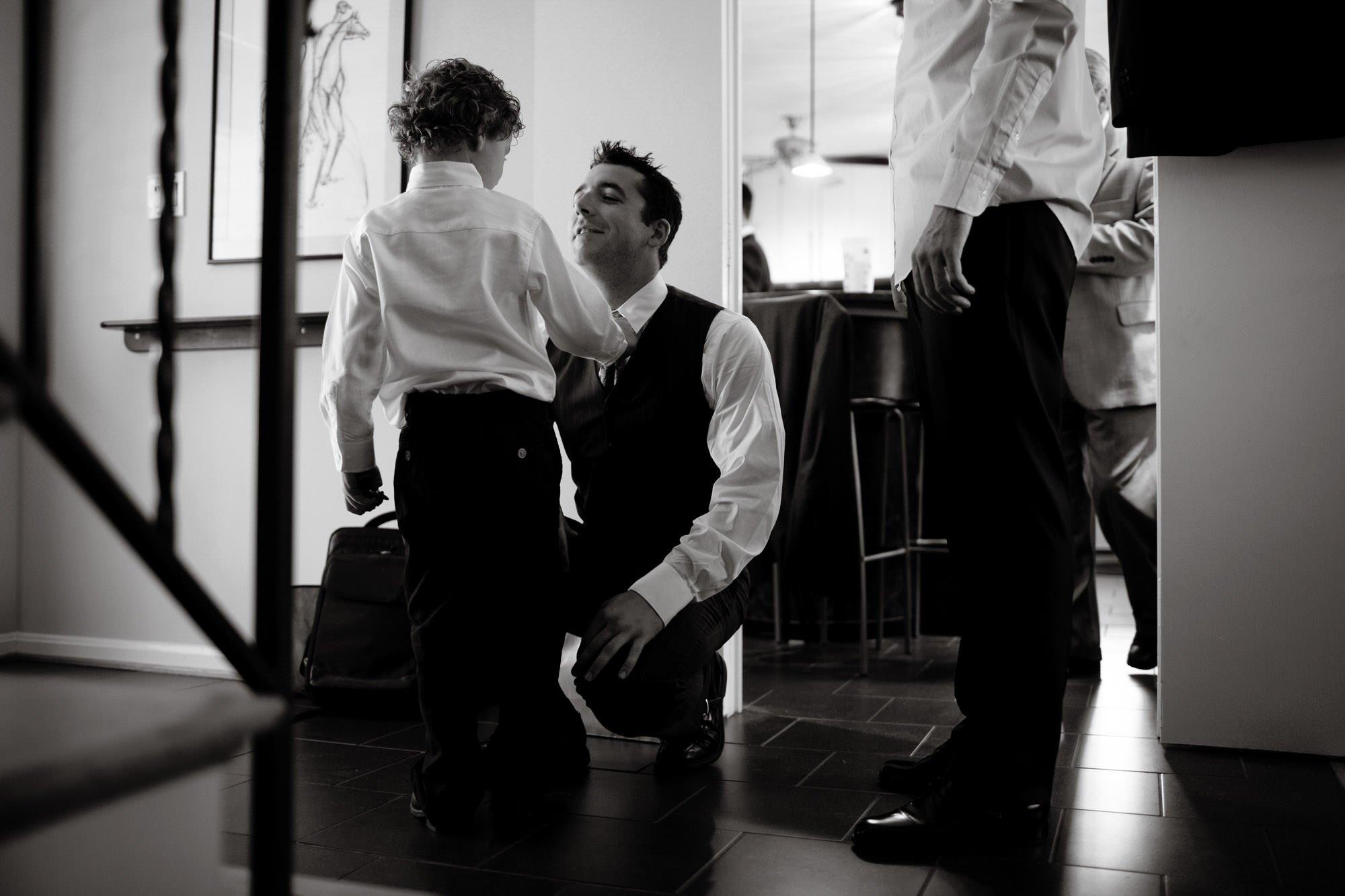 Groomsmen get ready before the wedding ceremony.