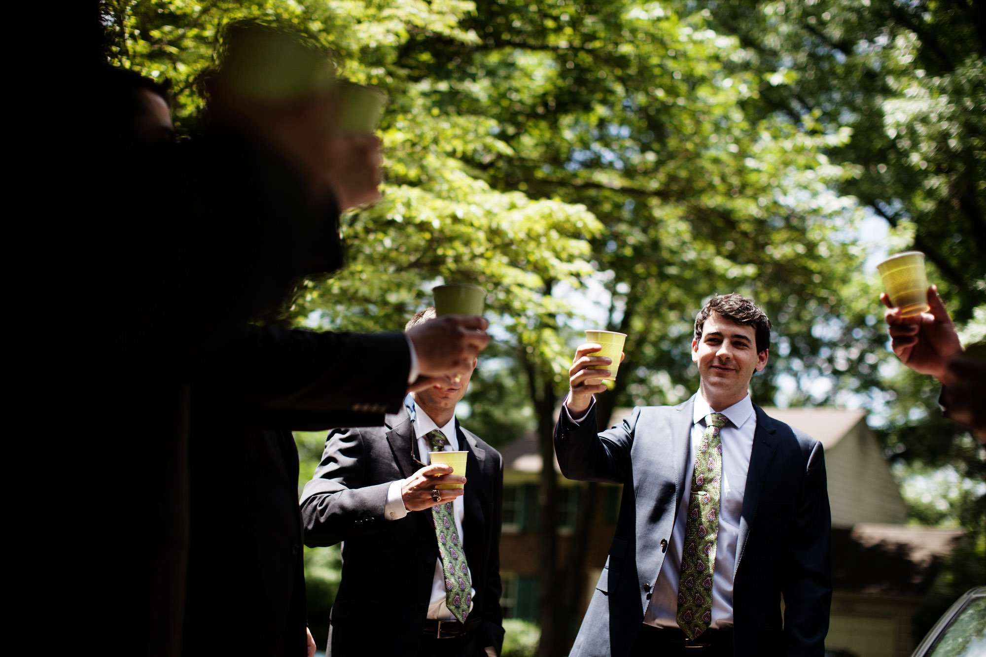 The groom toasts with his groomsmen before his Woodend Sanctuary & Mansion wedding.