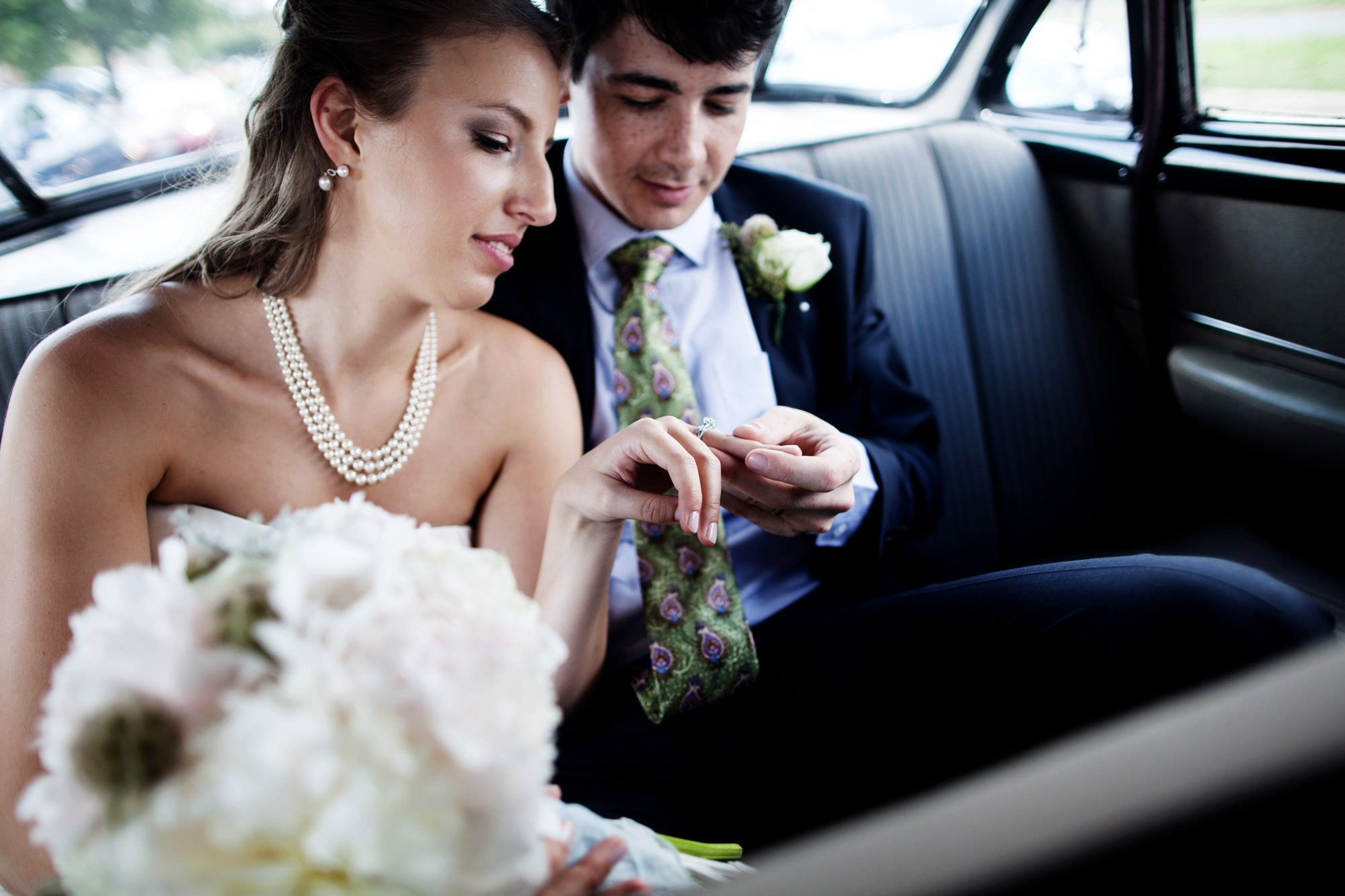 The bride and groom drive to their wedding reception at Woodend Sanctuary & Mansion.