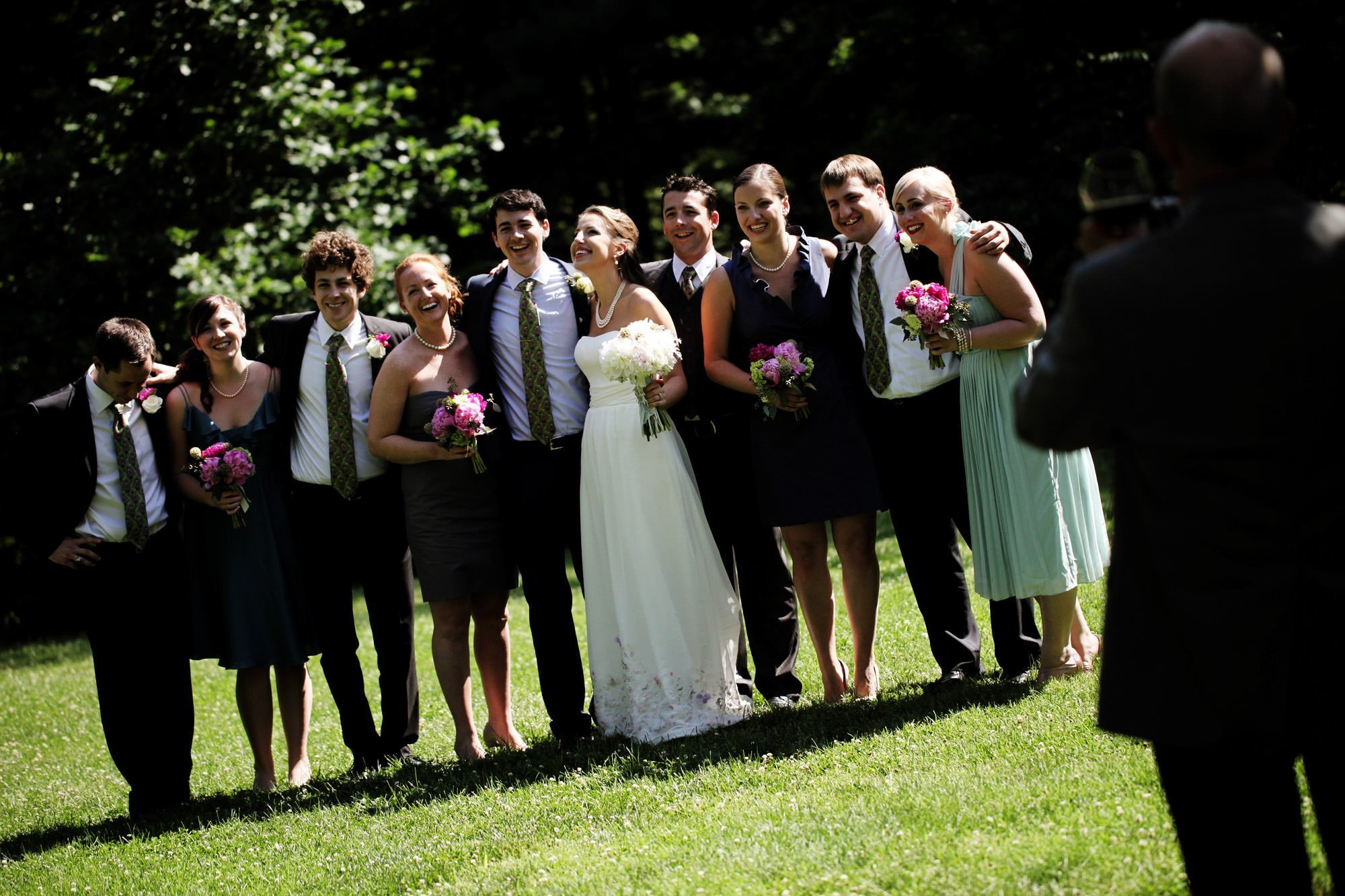 The wedding party poses for a portrait on the grounds of Woodend Sanctuary & Mansion.