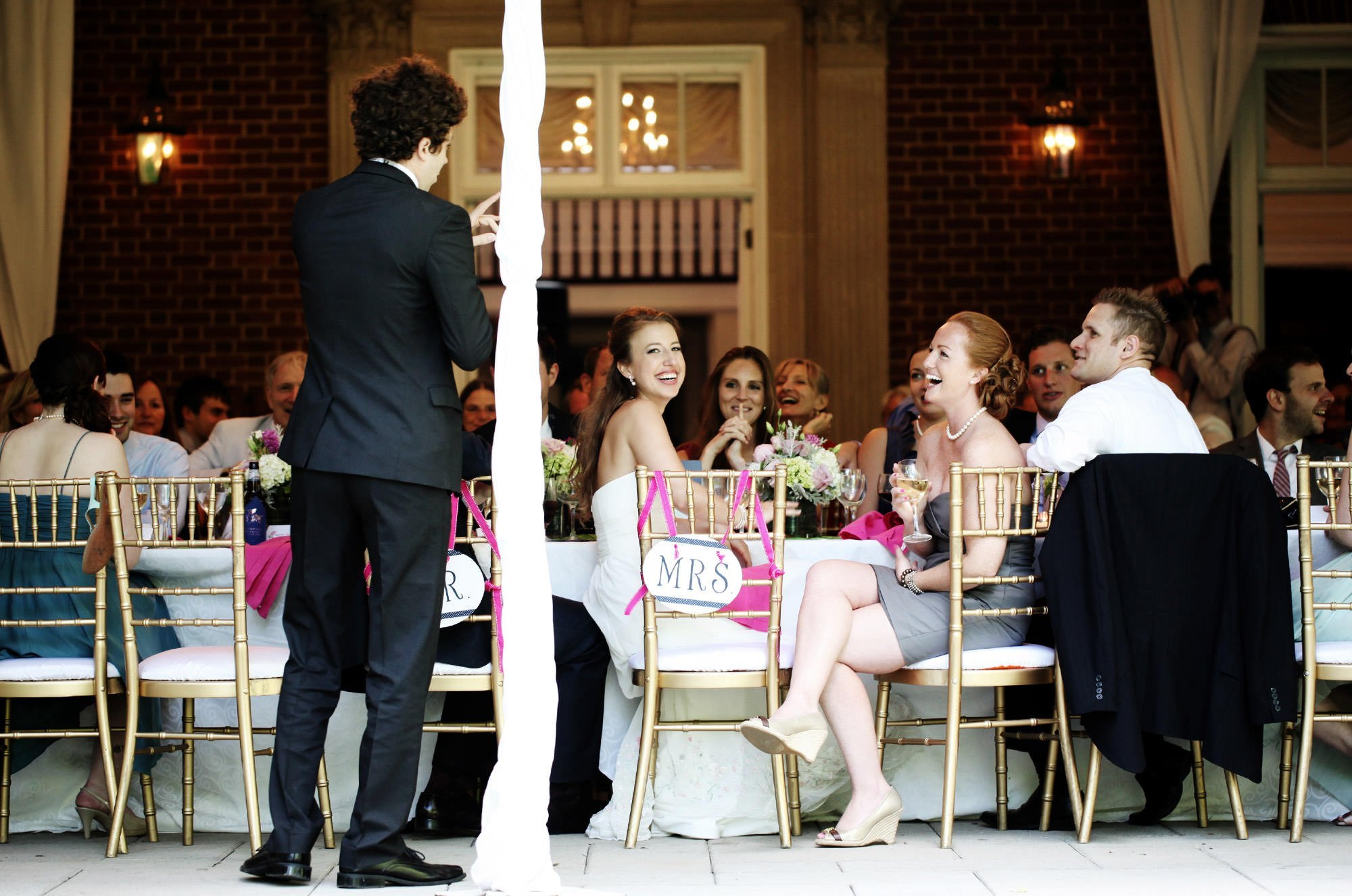 The wedding guests enjoy toasts during the reception at Woodend Sanctuary & Mansion.