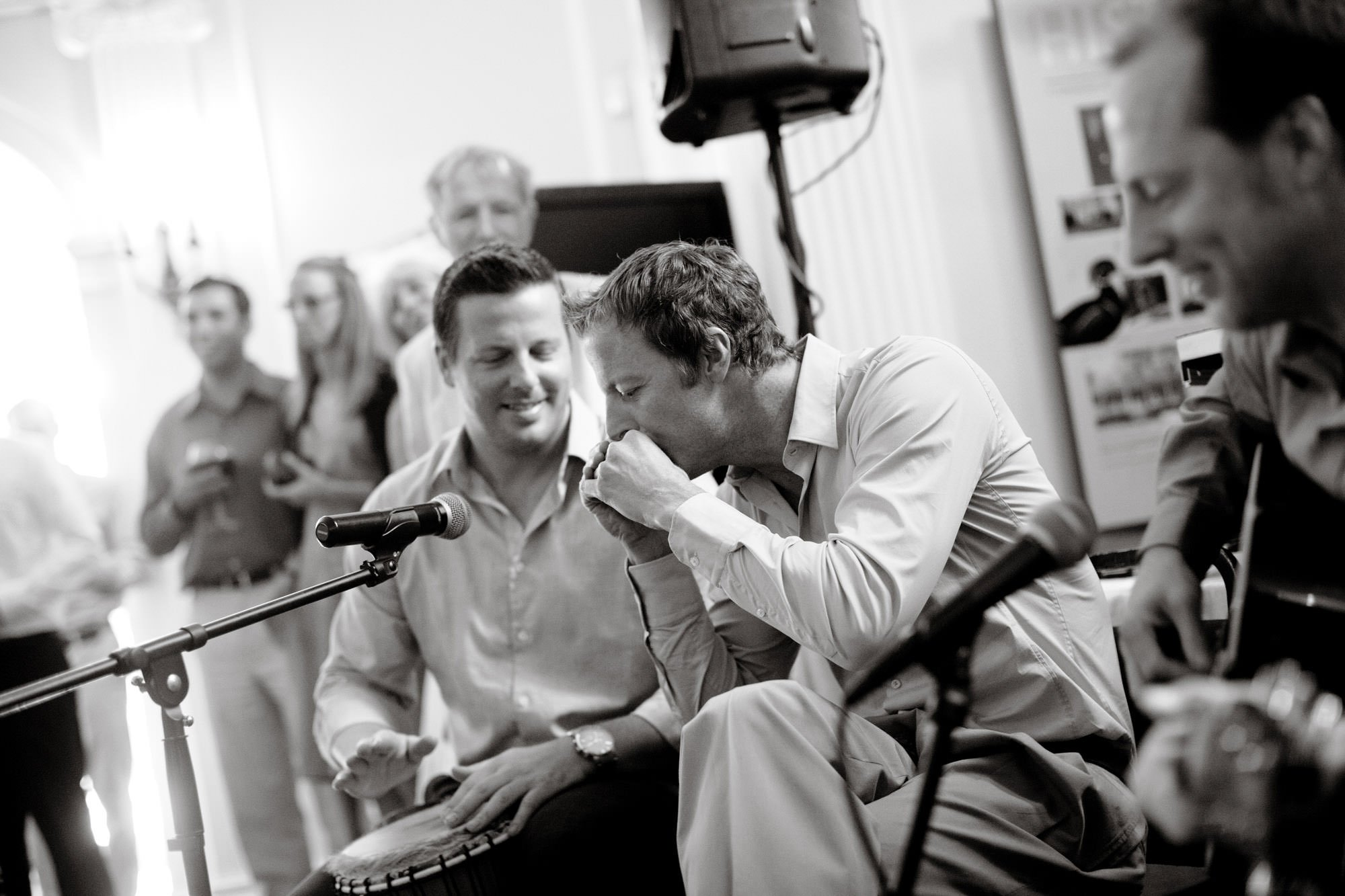 Guests play music during the first dance of this Woodend Sanctuary & Mansion wedding.