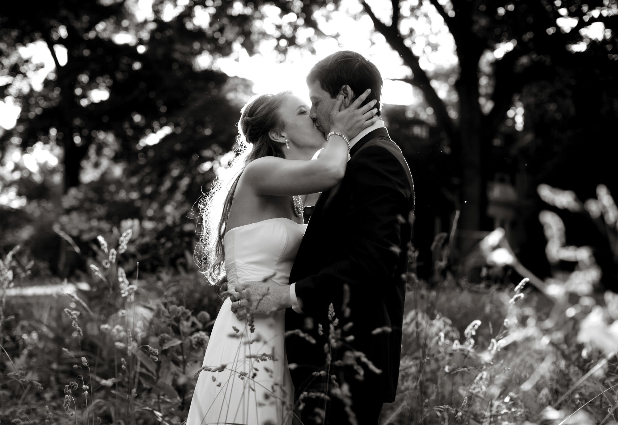 The bride and groom pose as the sun sets on their Woodend Sanctuary & Mansion wedding.