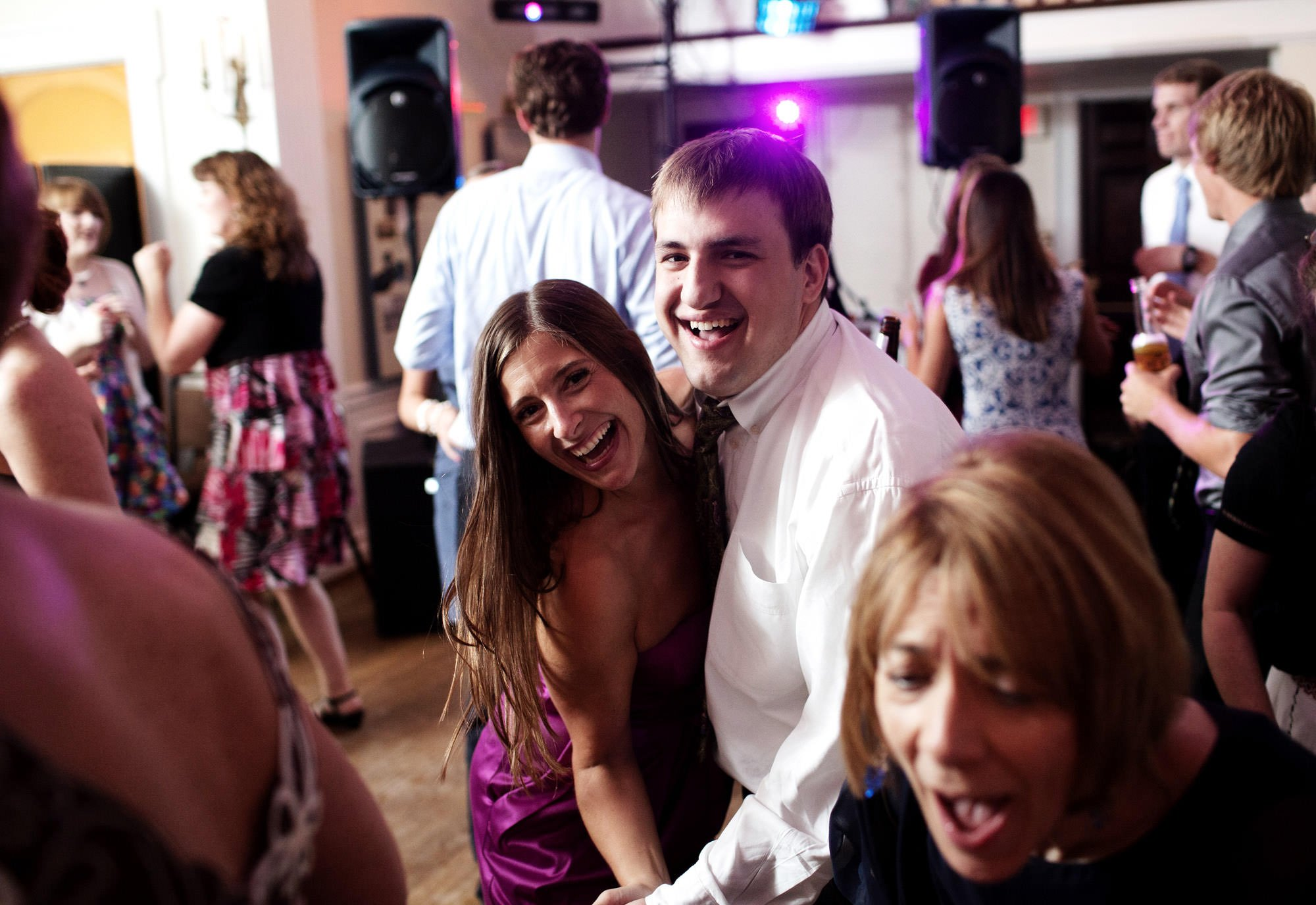 Guests dance during the wedding reception at Woodend Sanctuary & Mansion.