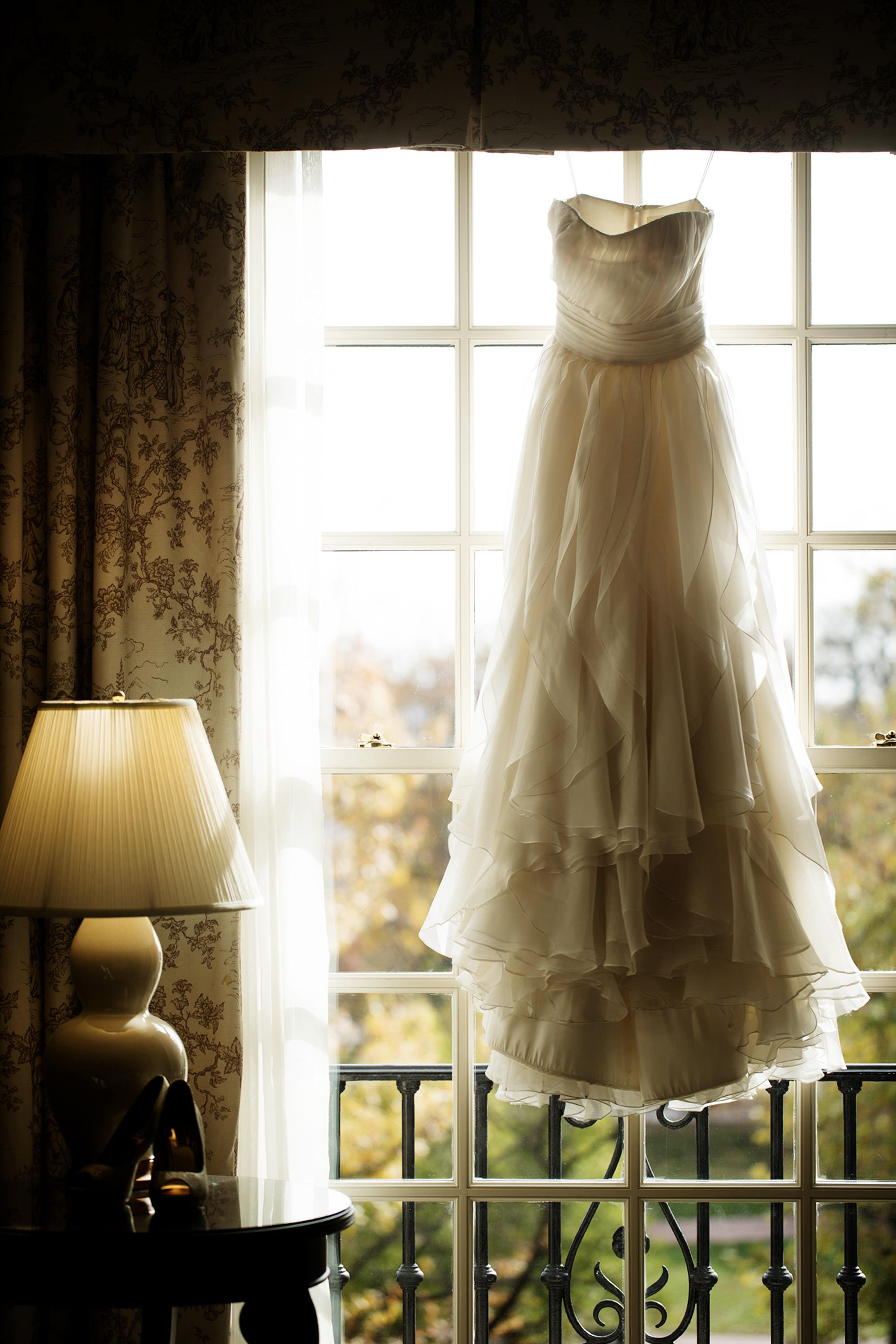 The bride's dress hangs in the Hay Adams hotel before the wedding ceremony.