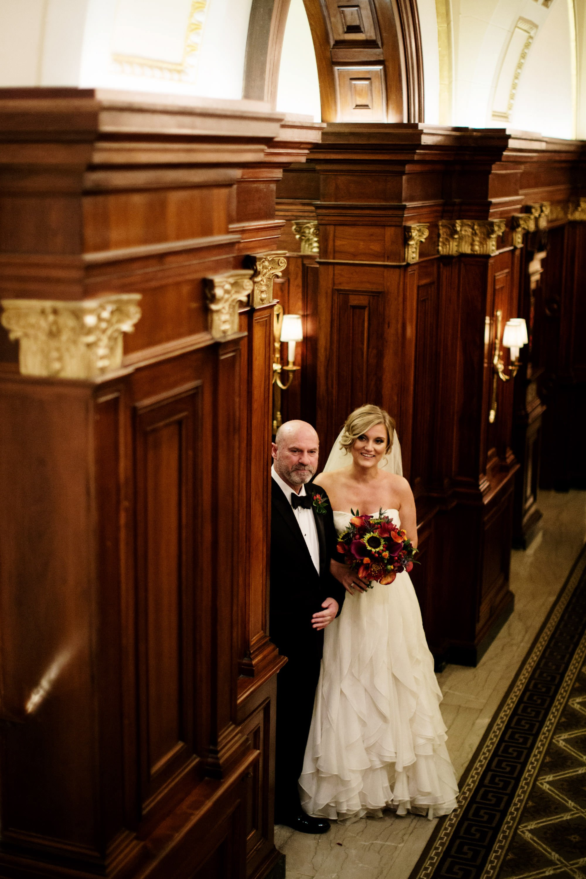 The bride waits with her father in the lobby of the Hay Adams Hotel in Washington, DC before the wedding ceremony.