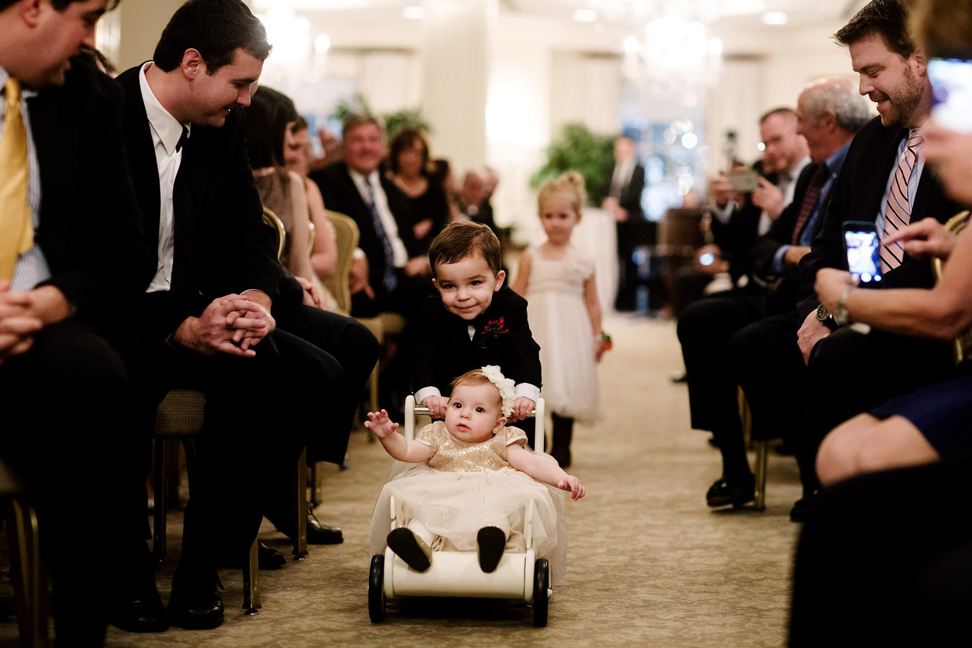Kids walk down the aisle during the Hay Adams DC Wedding ceremony.