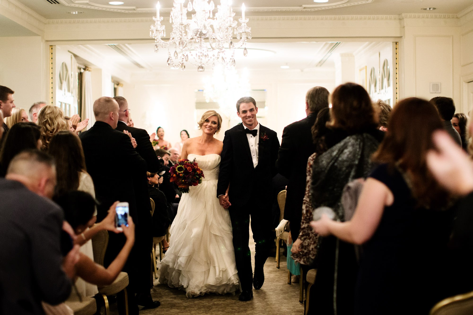 The bride and groom walk down the aisle following their Hay Adams DC Wedding ceremony.