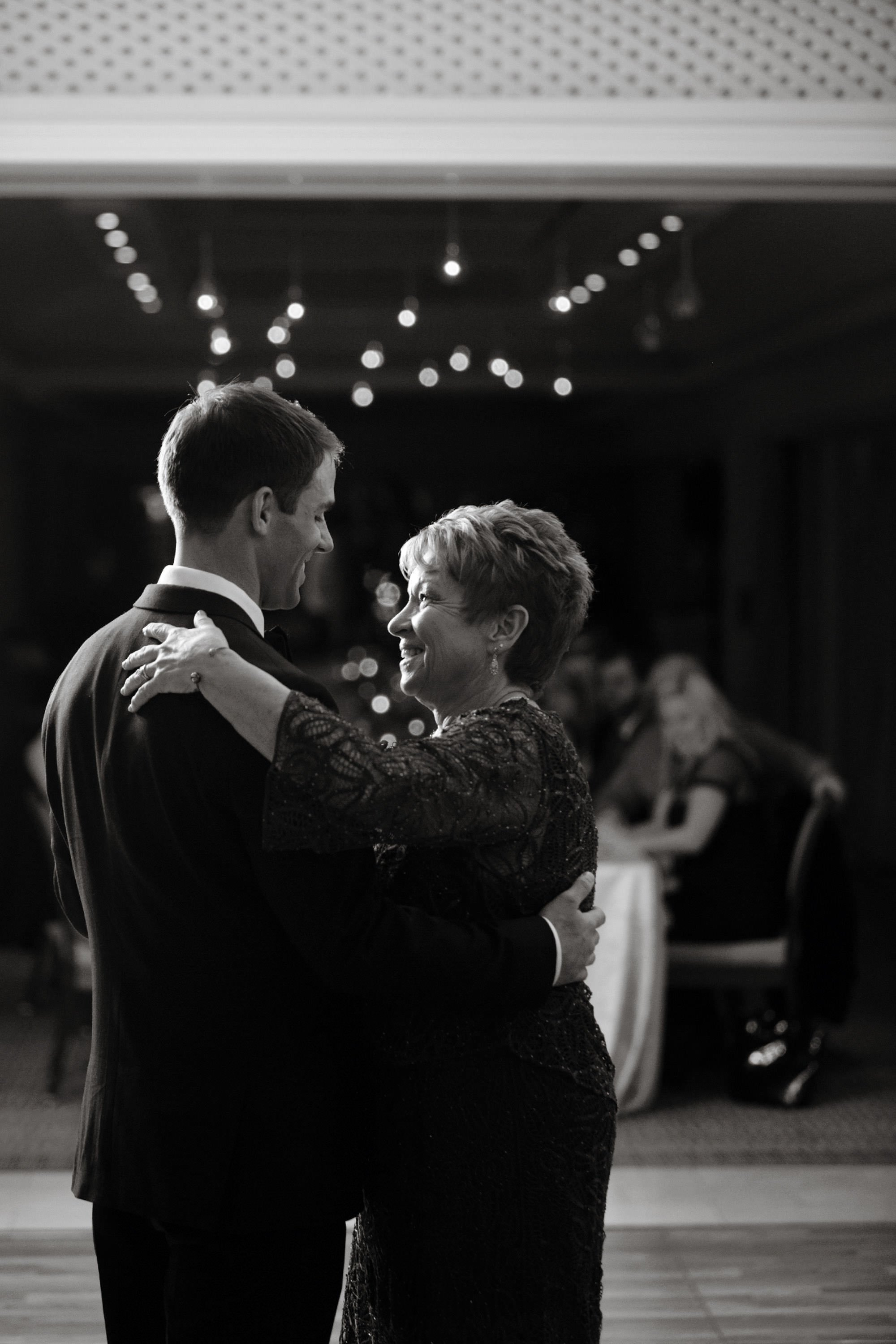 The mother of the bride dances with her son during the Hay Adams DC Wedding reception.